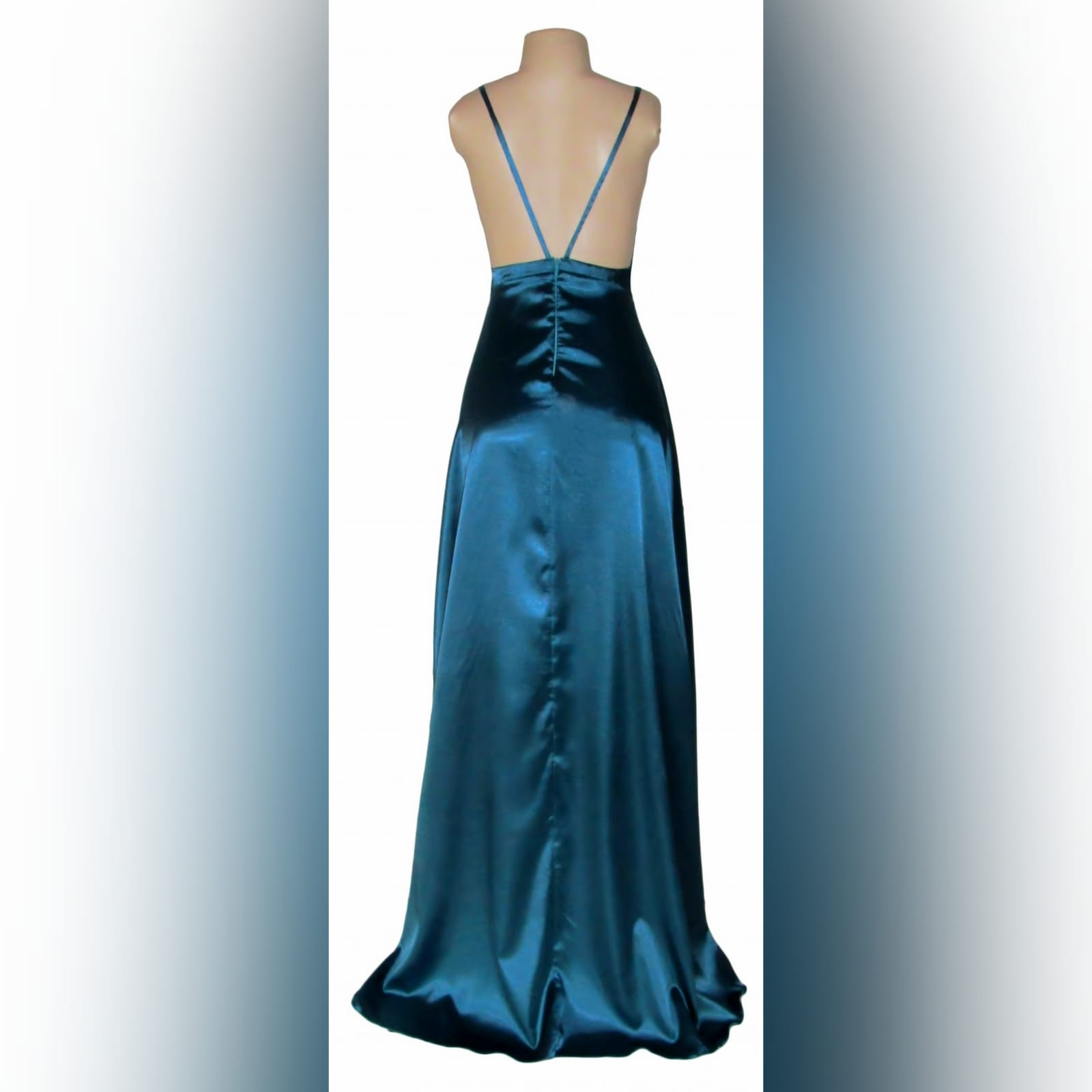 Teal long satin evening dress 3 teal long satin evening dress with a crossed bust neckline, backless design with 2 thin straps. With a small train.
