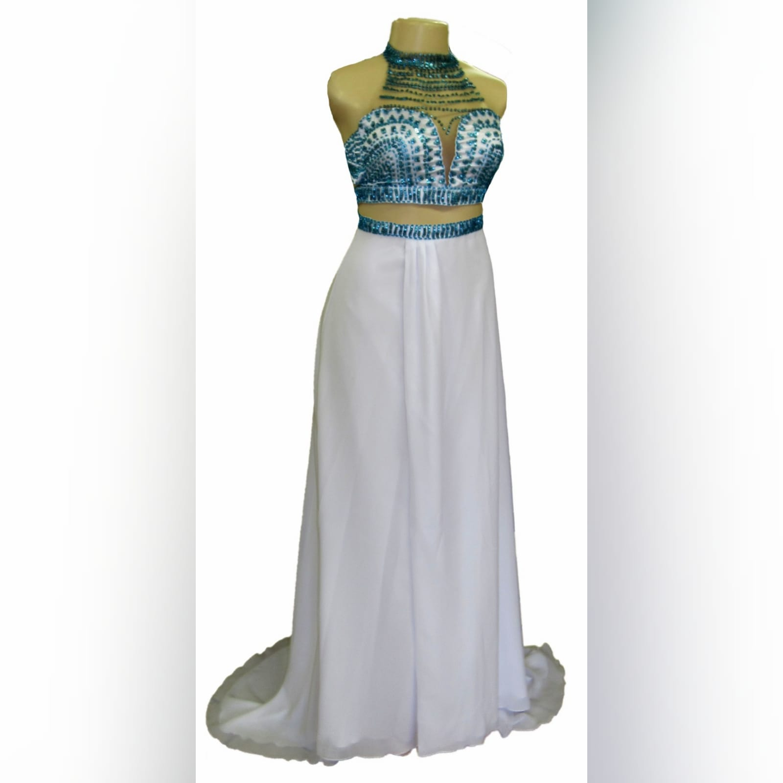 2 piece white and turquoise formal dress 9 2 piece white and turquoise formal dress. Crop top beaded with turquoise beads, chiffon skirt with a crossed slit and a train and a beaded waistband.