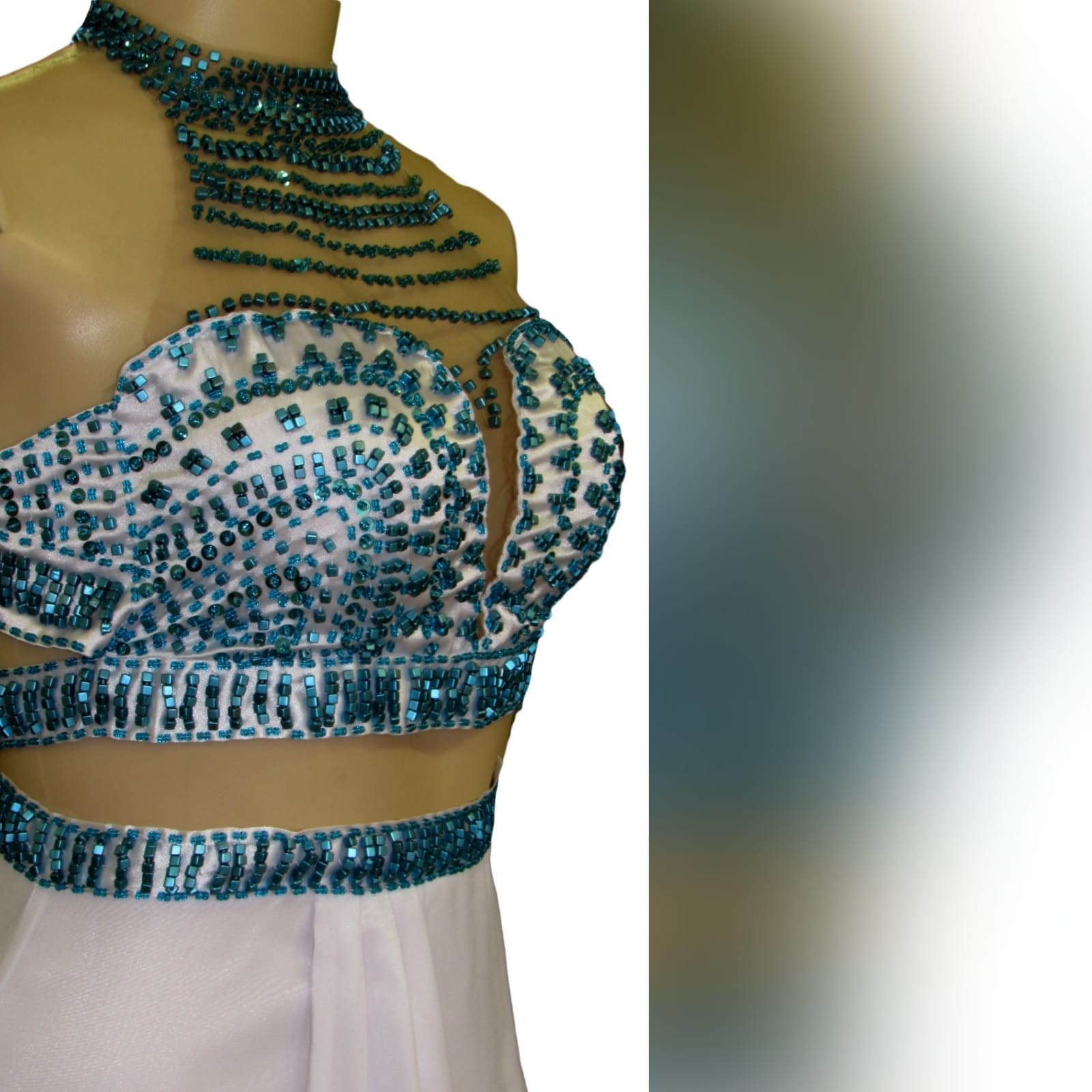 2 piece white and turquoise formal dress 7 2 piece white and turquoise formal dress. Crop top beaded with turquoise beads, chiffon skirt with a crossed slit and a train and a beaded waistband.