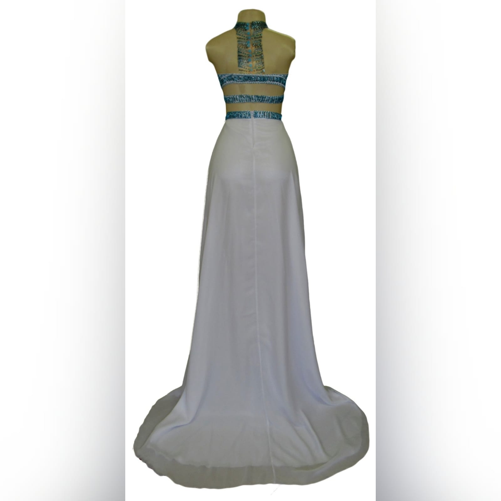 2 piece white and turquoise formal dress 8 2 piece white and turquoise formal dress. Crop top beaded with turquoise beads, chiffon skirt with a crossed slit and a train and a beaded waistband.