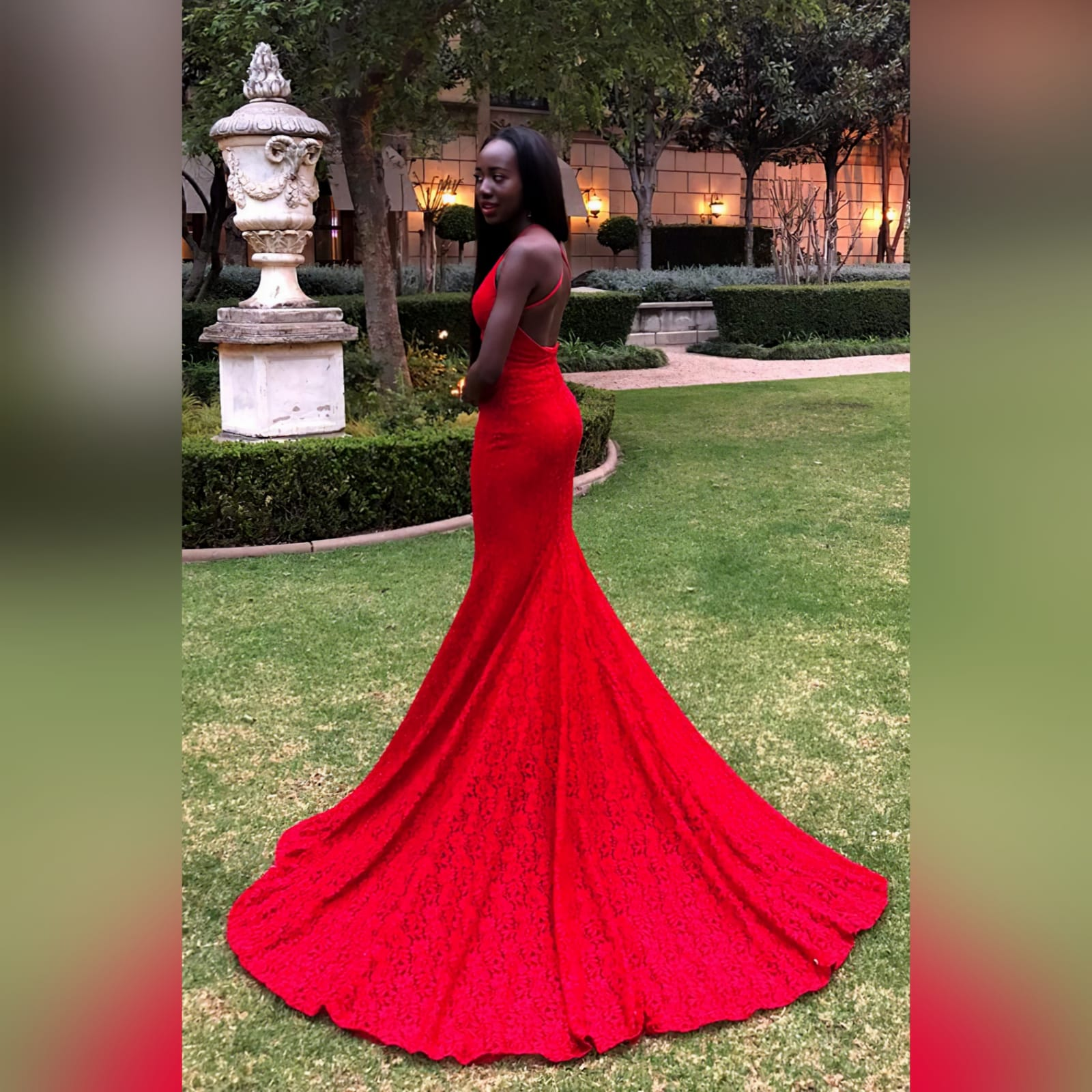 Bright red fully lace soft mermaid dress 1 bright red fully lace soft mermaid dress with a v neckline, thin shoulder straps and a low open back. With a wide long train.
