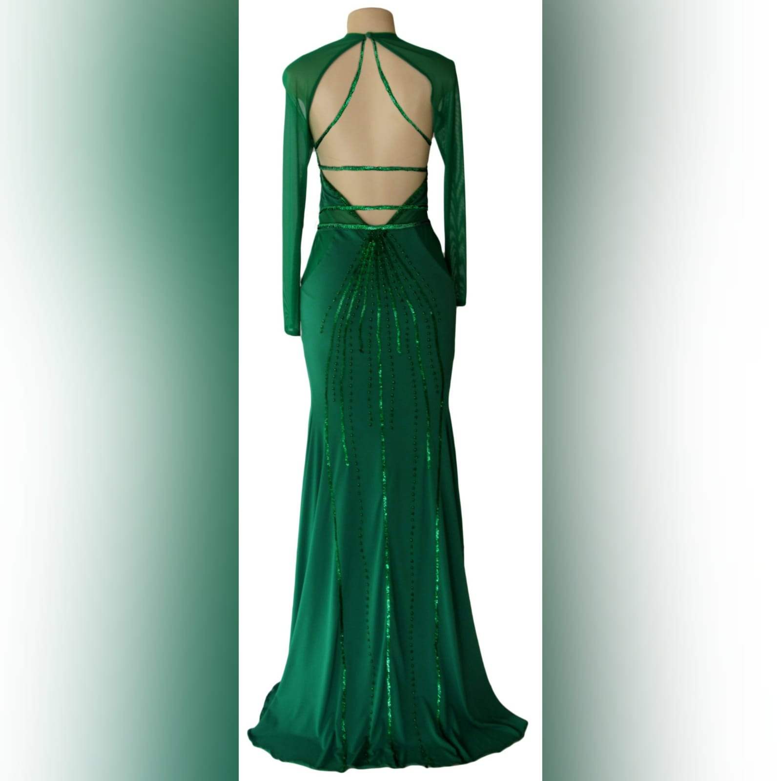 Green soft mermaid sexy unique evening dress 2 green soft mermaid sexy unique evening dress. Long sleeves, shoulders and leg panels in a slightly translucent fabric. A low open back detailed with sequins and beads.