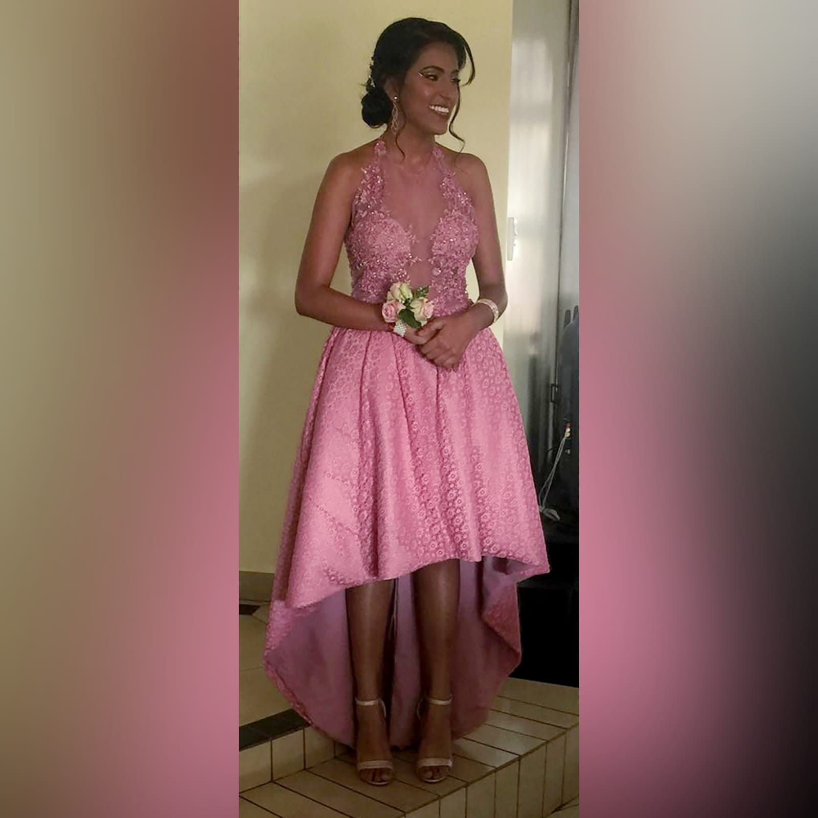 High low dusty pink prom dress 1 high low dusty pink prom dress with an illusion bodice detailed with beaded lace. Bottom fully laced.