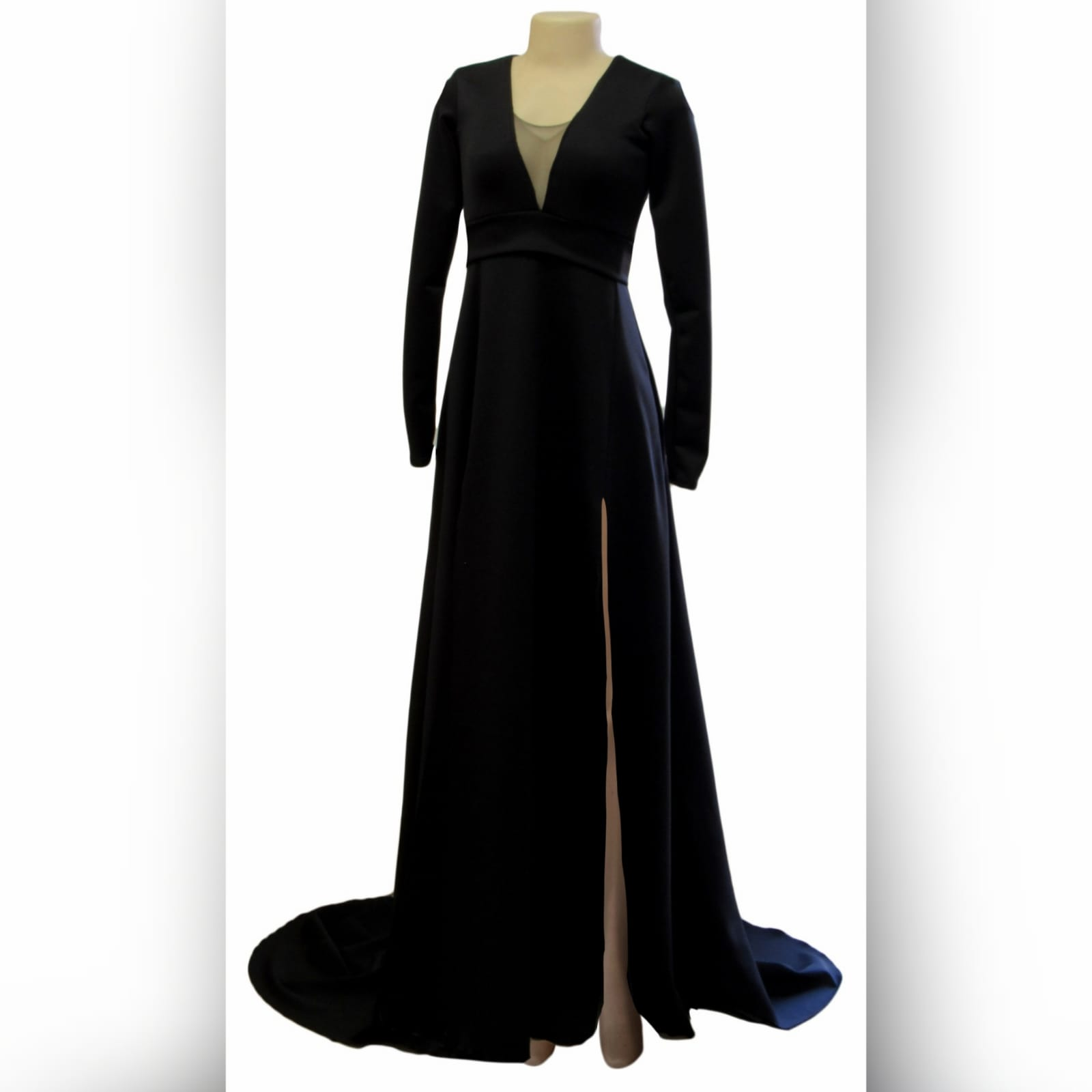 Long black a-line formal dress 5 long black a-line formal dress with an illusion v neckline, long sleeves a slit and a train.