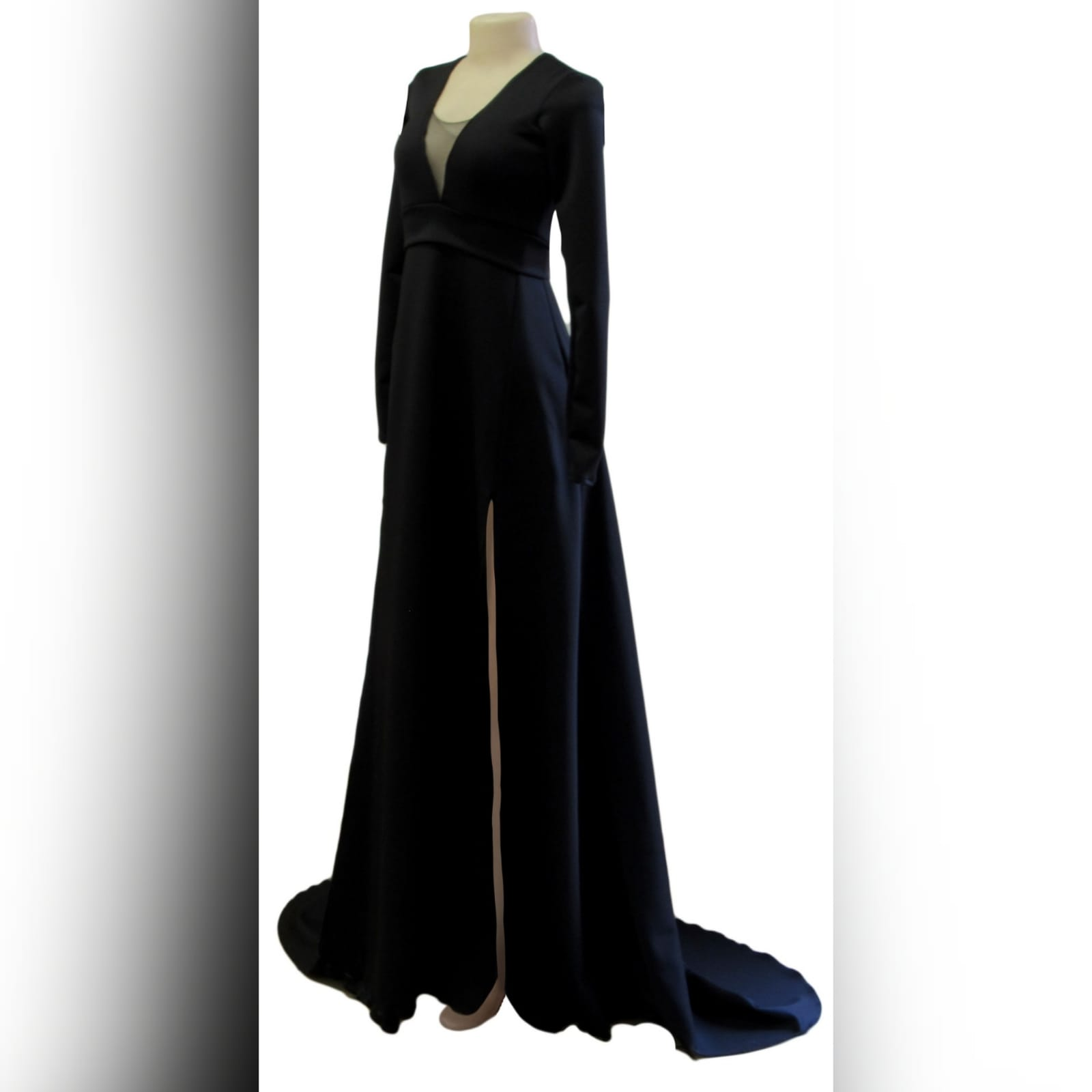 Long black a-line formal dress 1 long black a-line formal dress with an illusion v neckline, long sleeves a slit and a train.