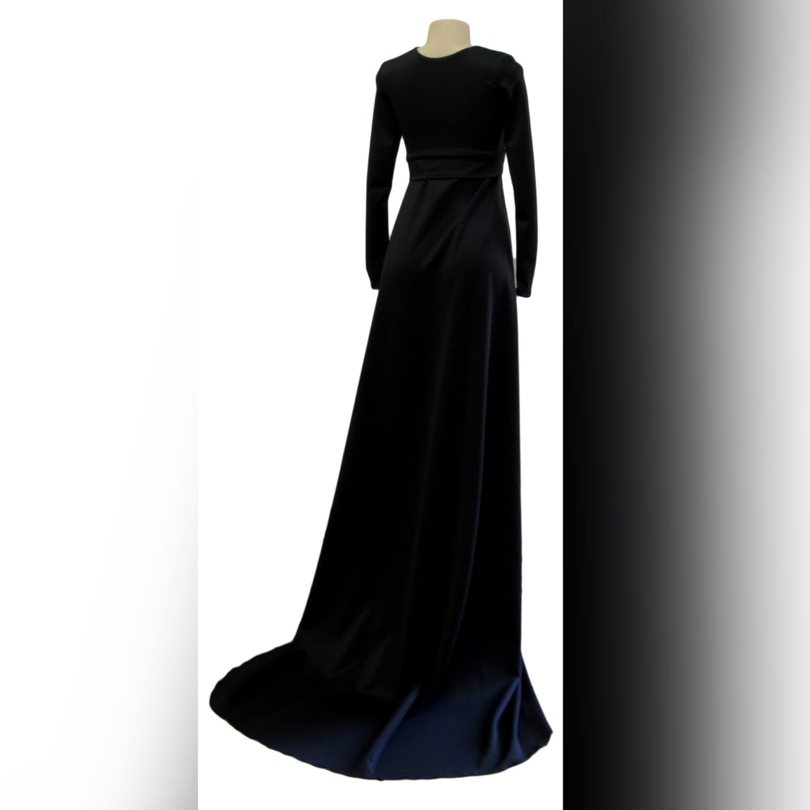 Long black a-line formal dress 4 long black a-line formal dress with an illusion v neckline, long sleeves a slit and a train.