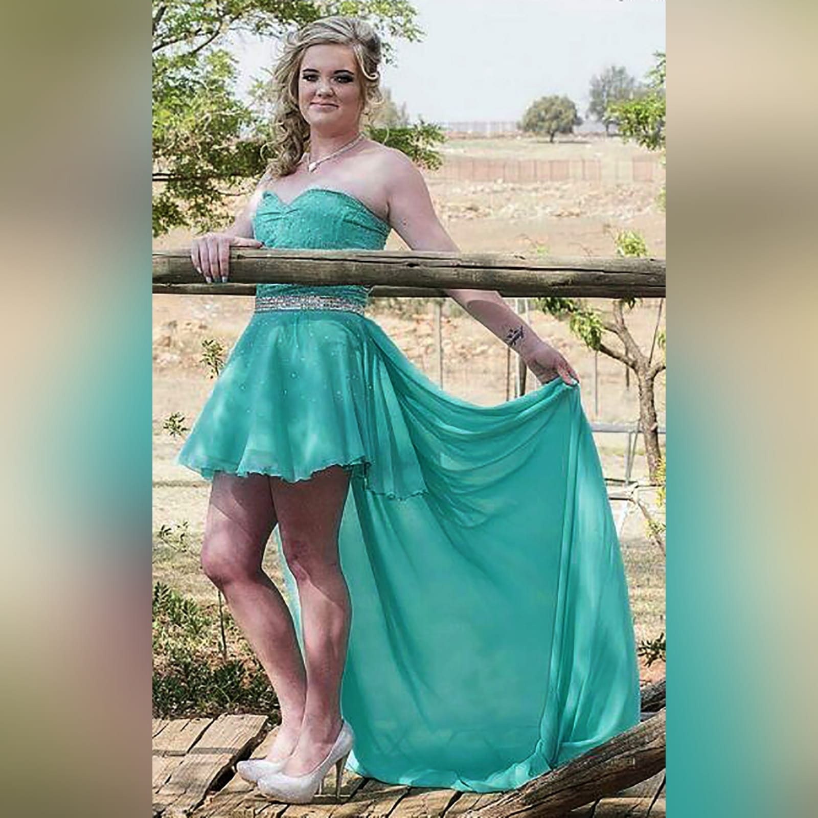 Turquoise 2 piece high low prom dress 1 turquoise 2 piece high low prom dress. Boobtube short dress with a sweetheart neckline and side tummy opening, lace-up back with bodice beaded in silver. With a detachable chiffon train creating a high low effect, with a wide silver belt.