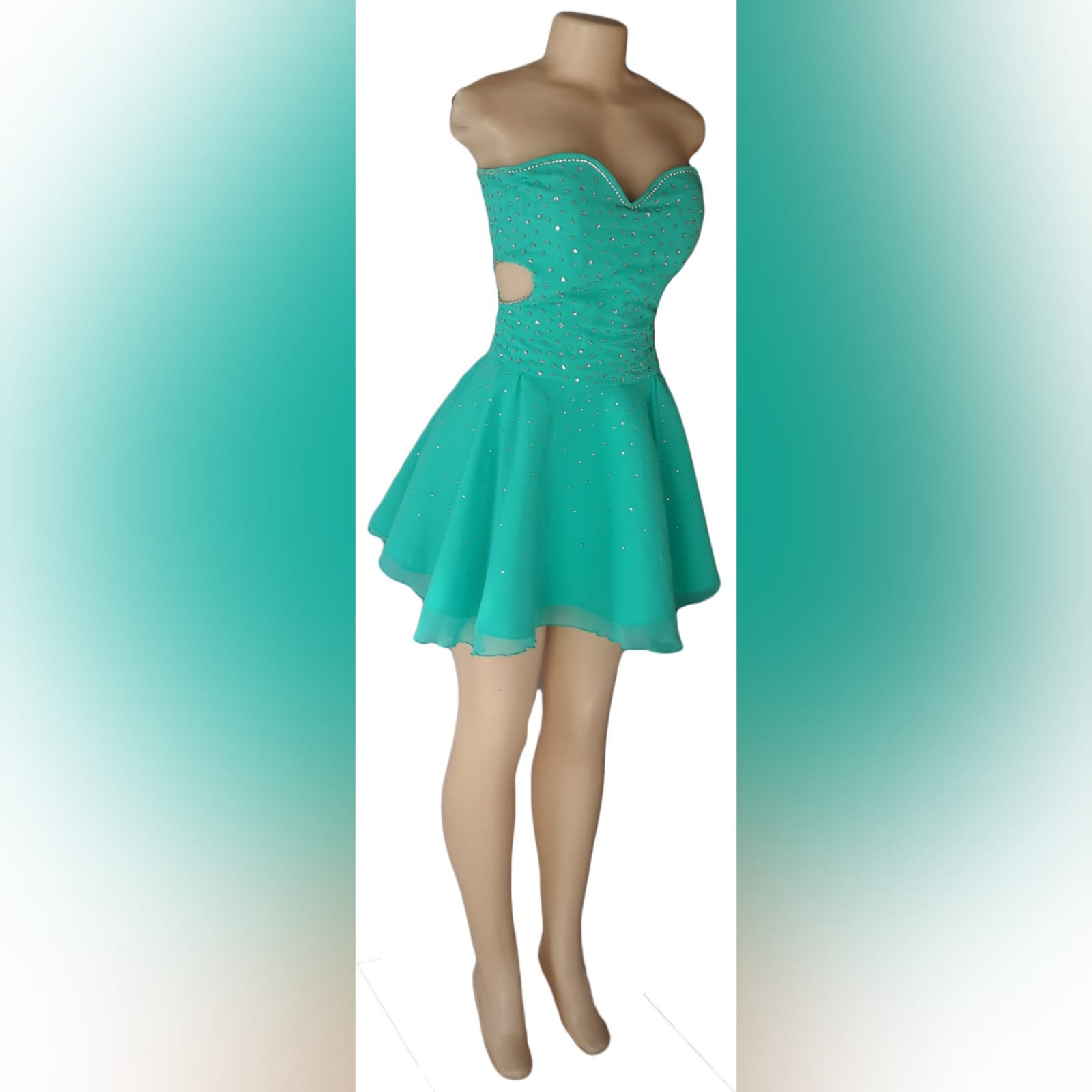 Turquoise 2 piece high low prom dress 3 turquoise 2 piece high low prom dress. Boobtube short dress with a sweetheart neckline and side tummy opening, lace-up back with bodice beaded in silver. With a detachable chiffon train creating a high low effect, with a wide silver belt.