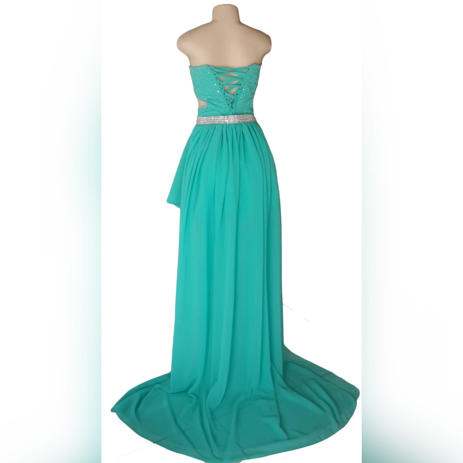 Turquoise 2 piece high low prom dress 5 turquoise 2 piece high low prom dress. Boobtube short dress with a sweetheart neckline and side tummy opening, lace-up back with bodice beaded in silver. With a detachable chiffon train creating a high low effect, with a wide silver belt.