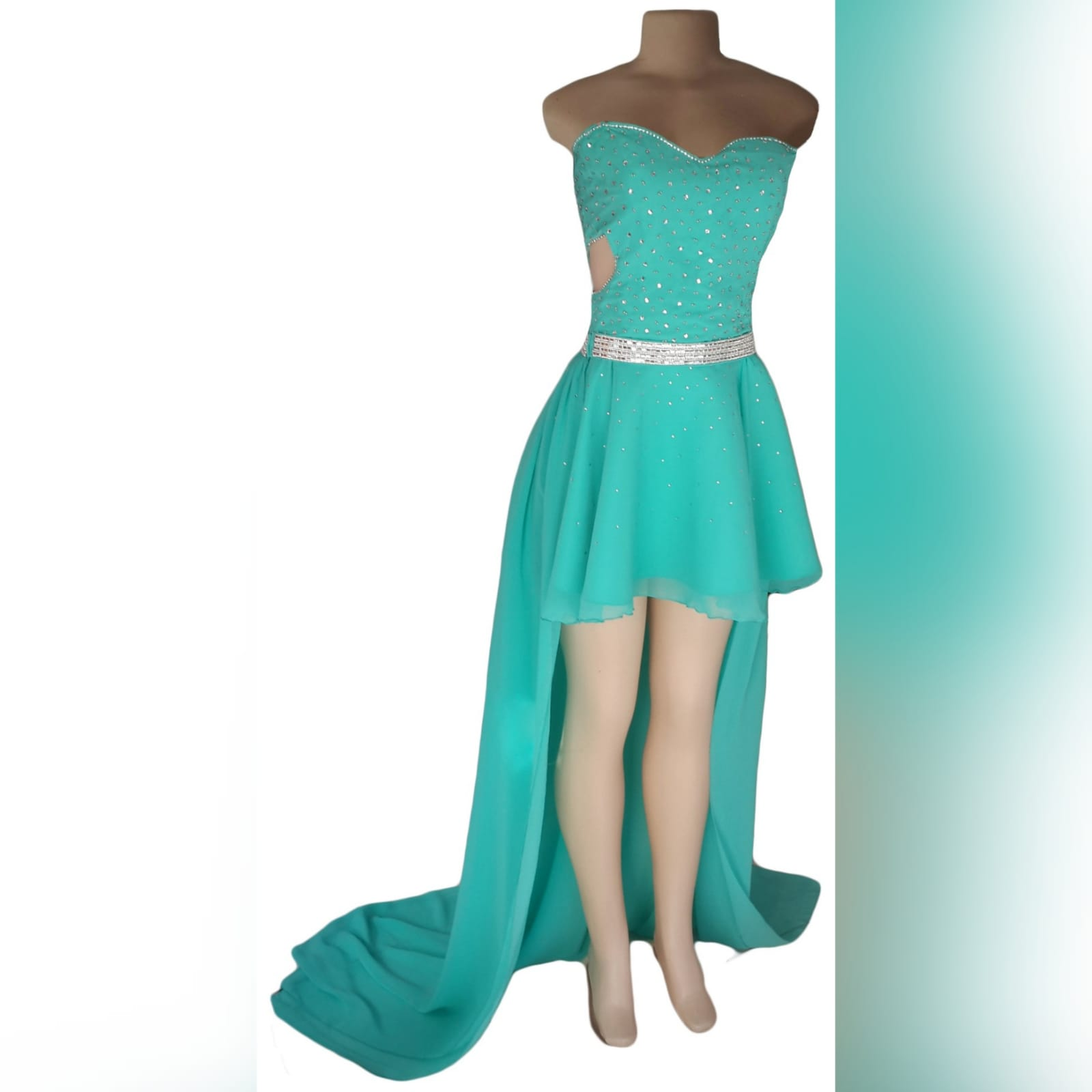 Turquoise 2 piece high low prom dress 6 turquoise 2 piece high low prom dress. Boobtube short dress with a sweetheart neckline and side tummy opening, lace-up back with bodice beaded in silver. With a detachable chiffon train creating a high low effect, with a wide silver belt.