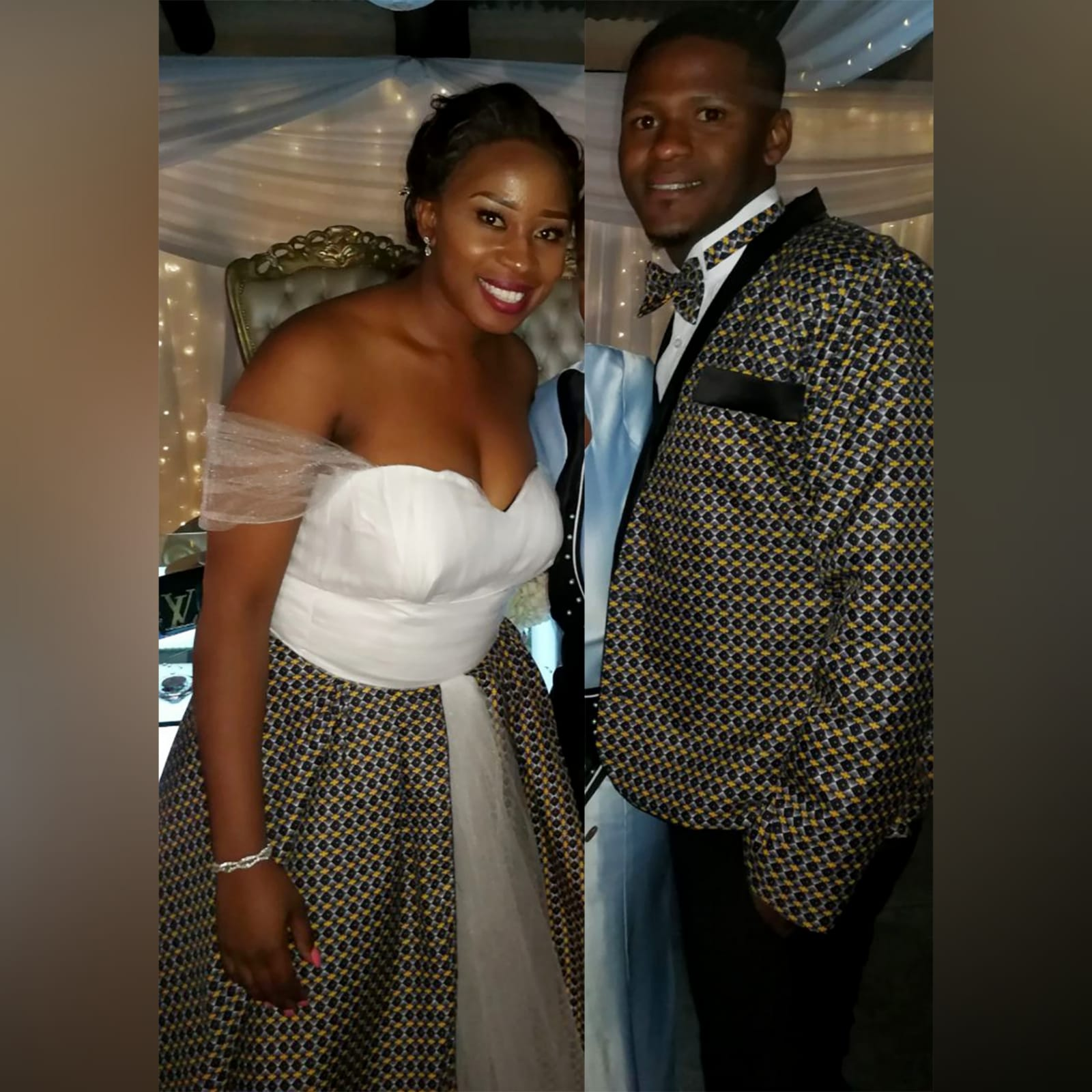 White and brown african traditional wedding dress 4 white and brown african traditional wedding dress. Sweetheart neckline, off shoulder tulle straps with a tulle skirt and an overlayer of african traditional fabric. Grooms matching blazer and bowtie.