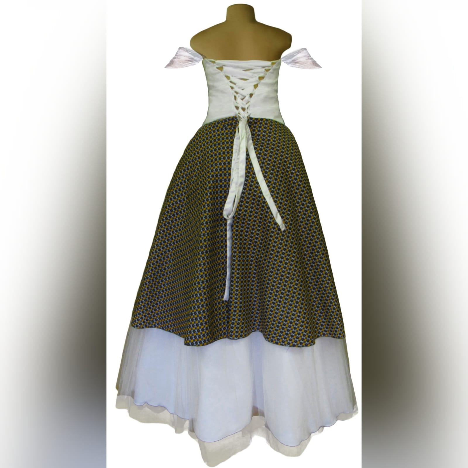 White and brown african traditional wedding dress 5 white and brown african traditional wedding dress. Sweetheart neckline, off shoulder tulle straps with a tulle skirt and an overlayer of african traditional fabric. Grooms matching blazer and bowtie.