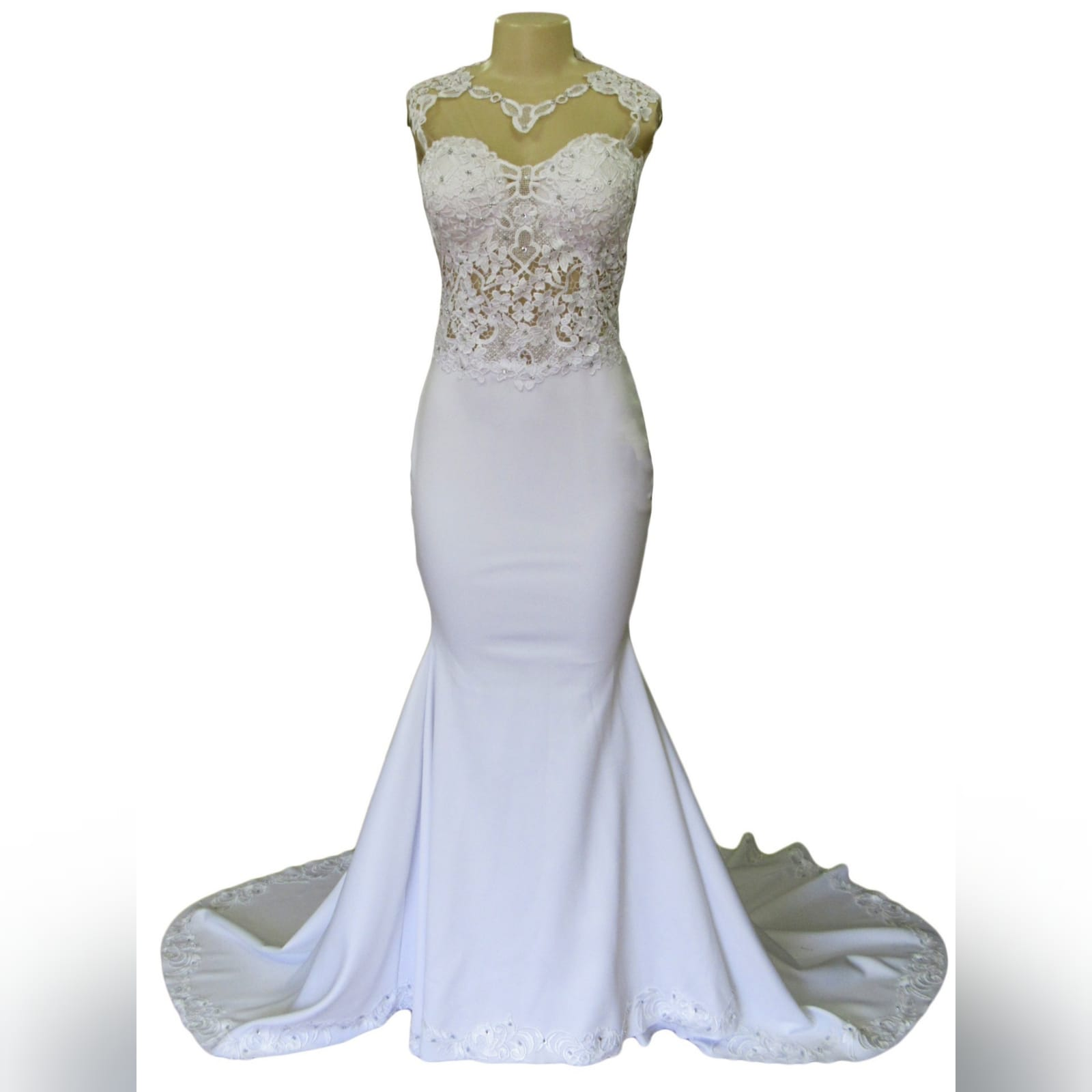 White soft mermaid lace wedding dress illusion back 11 white soft mermaid lace wedding dress with an illusion neckline detailed with lace. Illusion back detailed with buttons and lace and a lace bodice. Bottom with a train and border with lace detail. Blush length veil with lace edging.