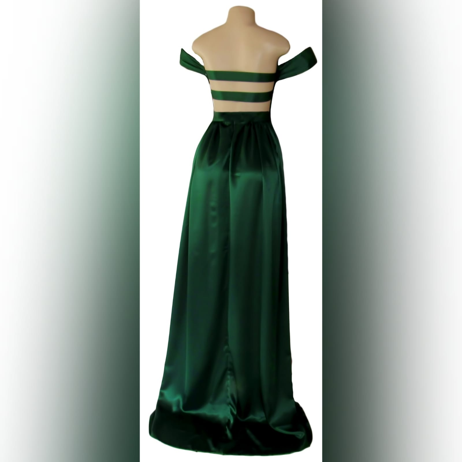 Emerald green satin flowy formal dress 4 emerald green satin off shoulder flowy formal dress, with a pleated bodice off shoulder short sleeves, naked back detailed with straps. A crossed slit and a small train.