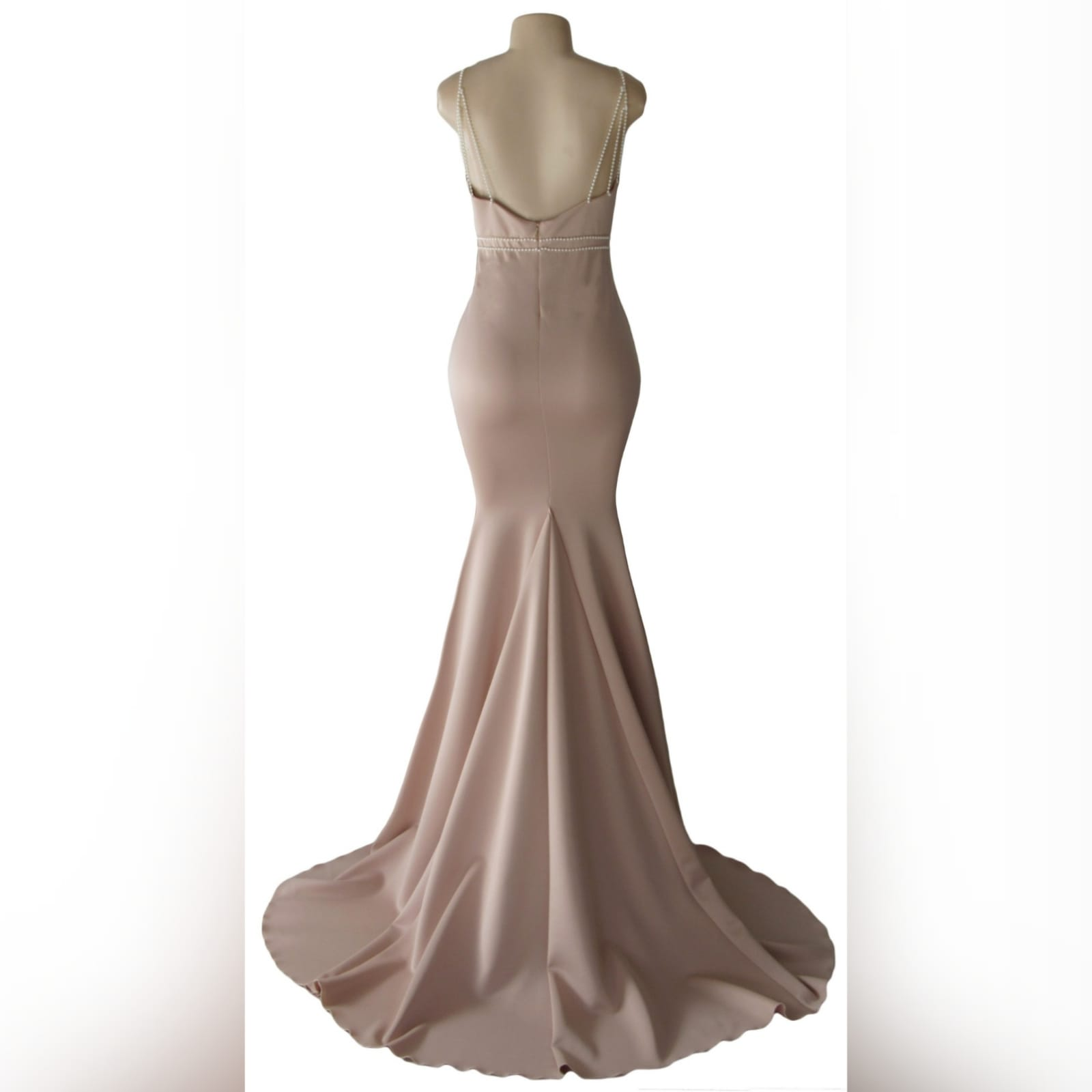 Pink nude soft mermaid prom dress with pearls 2 pink nude soft mermaid prom dress with an illusion plunging neckline, with a low open back, detailed with pearls on the waist and shoulder straps.