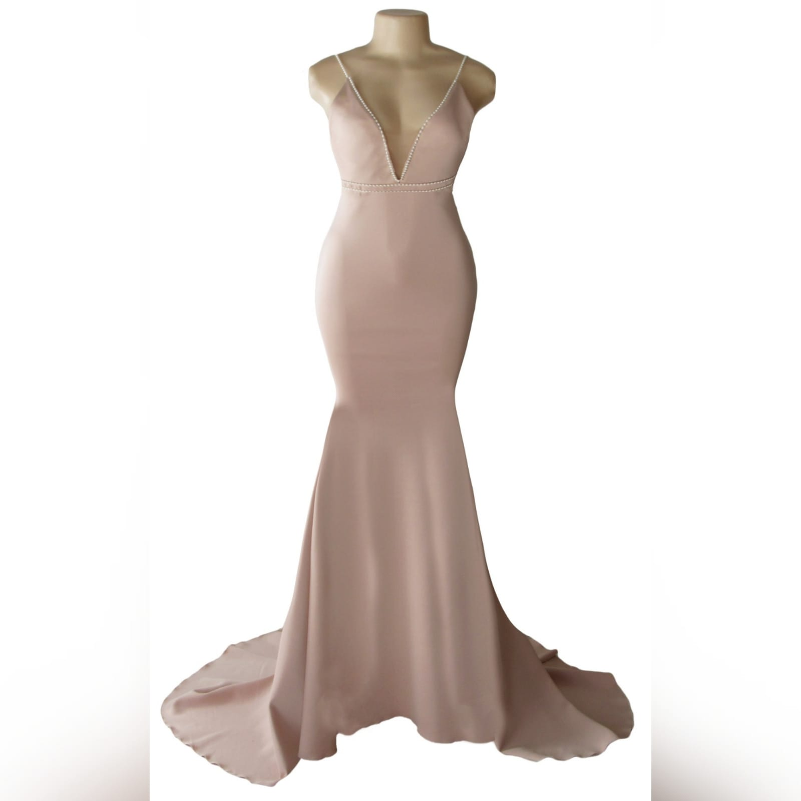Pink nude soft mermaid prom dress with pearls 5 pink nude soft mermaid prom dress with an illusion plunging neckline, with a low open back, detailed with pearls on the waist and shoulder straps.