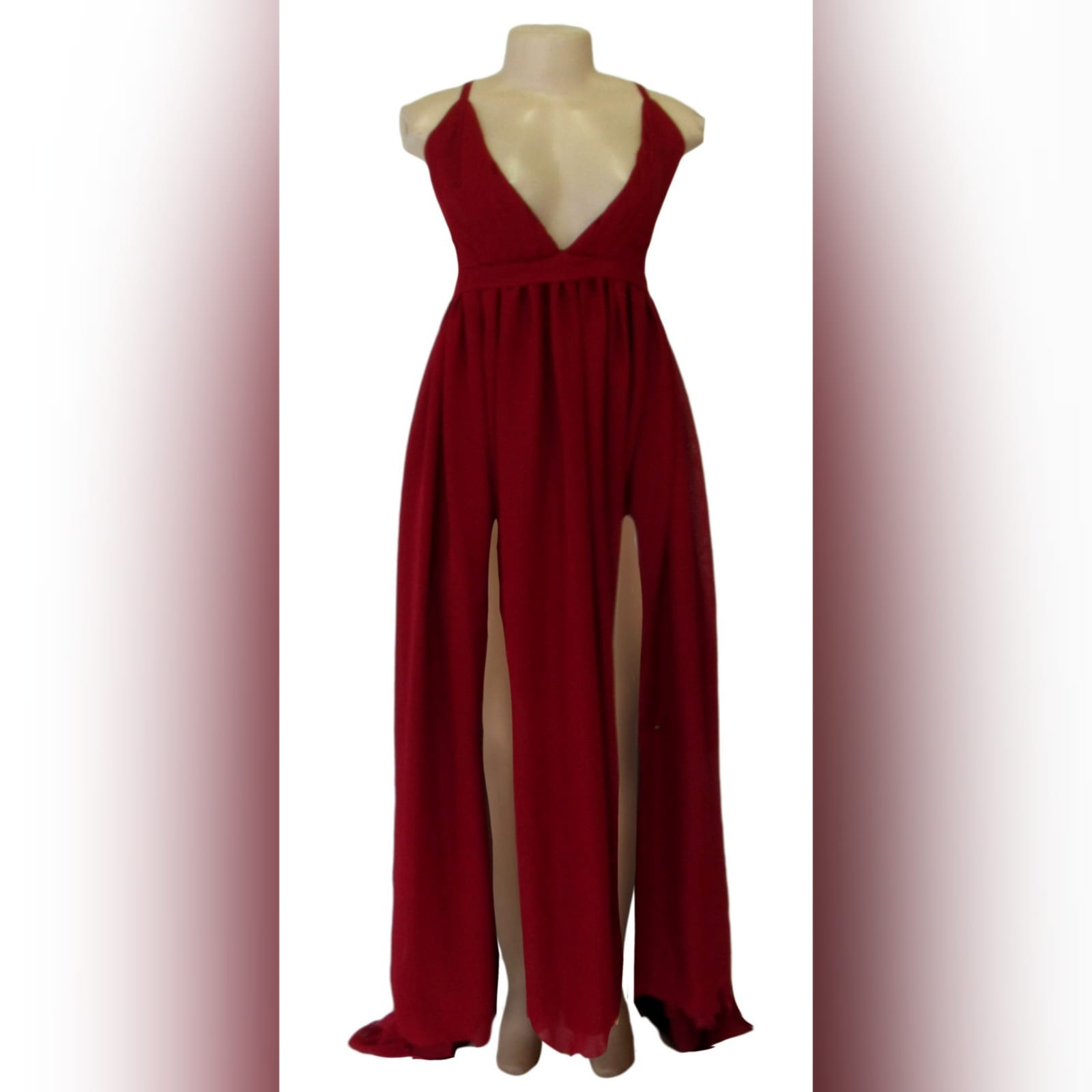 Red long chiffon formal dress 5 red long chiffon formal dress with a v neckline, 2 high slits, rounded open back with thin crossed shoulder straps.