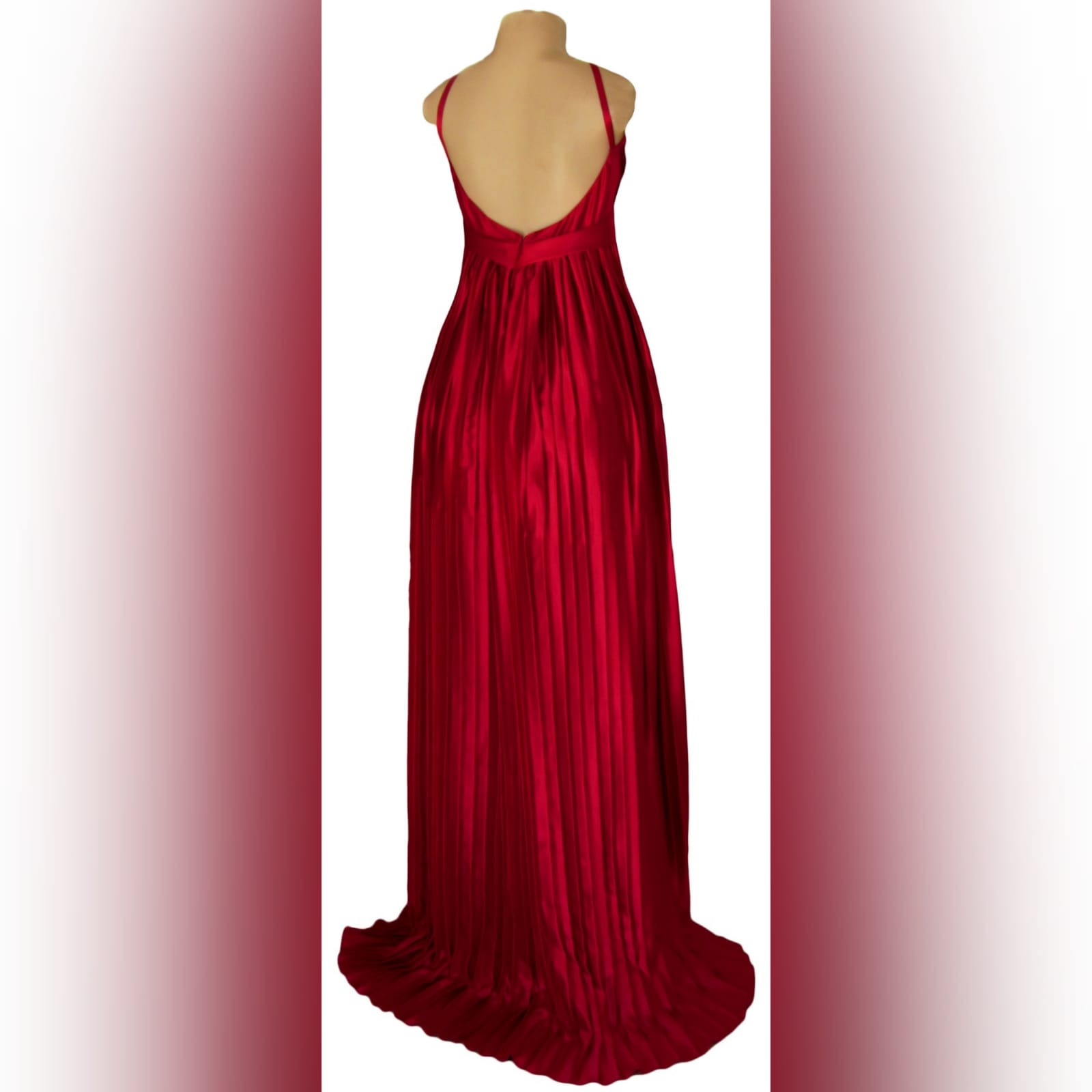 Red pleated satin long evening dress 4 red pleated satin long evening dress with a plunging neckline that closes with a lace-up. Rounded open back. Flowy pleated bottom with a small train.