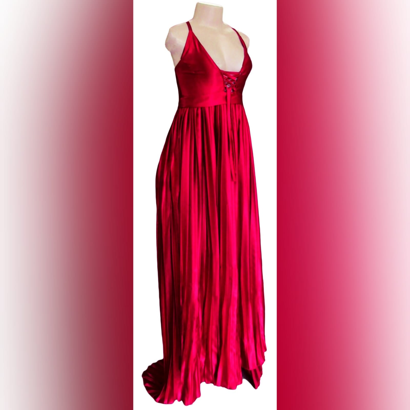 Red pleated satin long evening dress 5 red pleated satin long evening dress with a plunging neckline that closes with a lace-up. Rounded open back. Flowy pleated bottom with a small train.