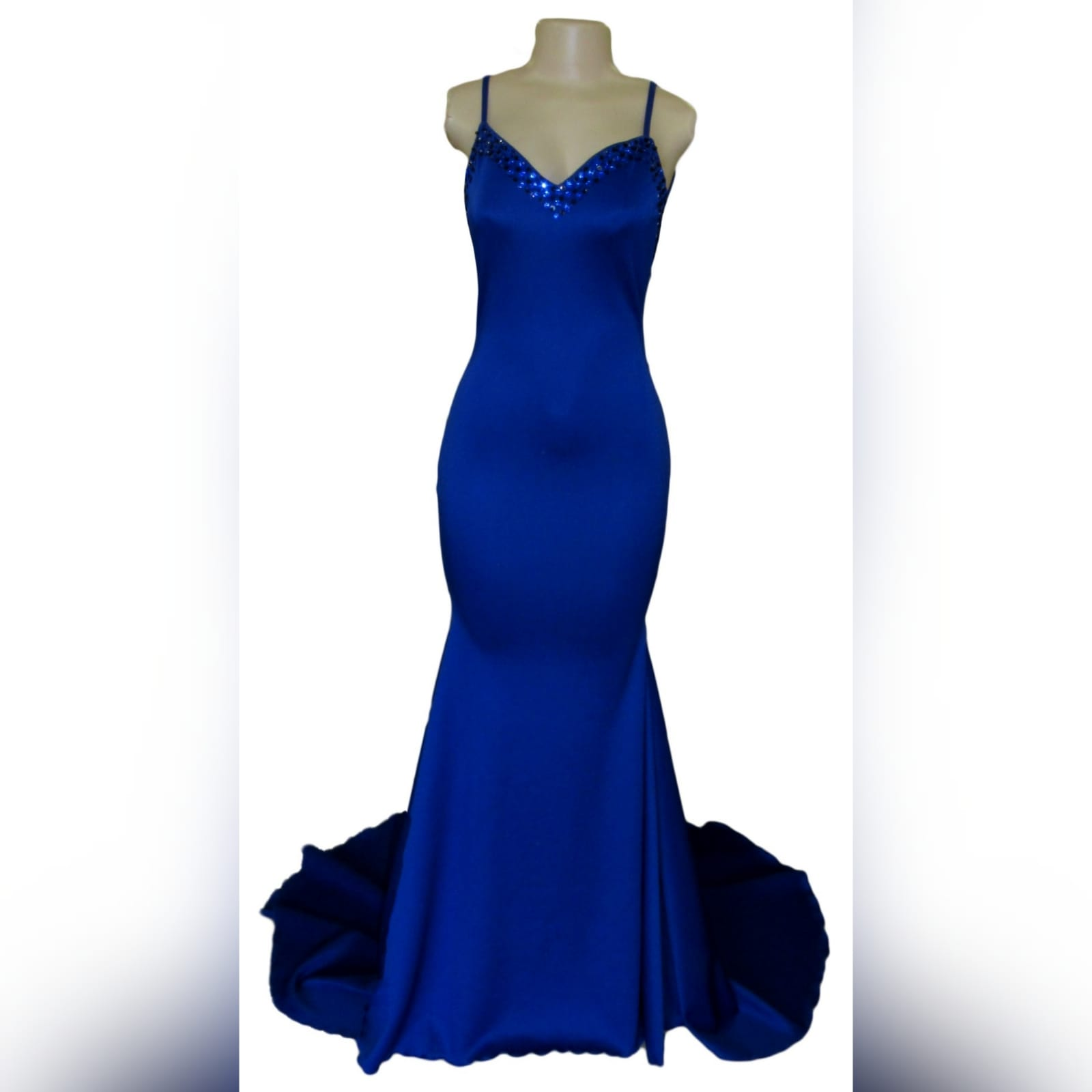 Royal blue soft mermaid beaded prom dress 2 royal blue soft mermaid beaded prom dress, with a v neckline, low v open back detailed with blue and black beads, thin shoulder straps and a long train.