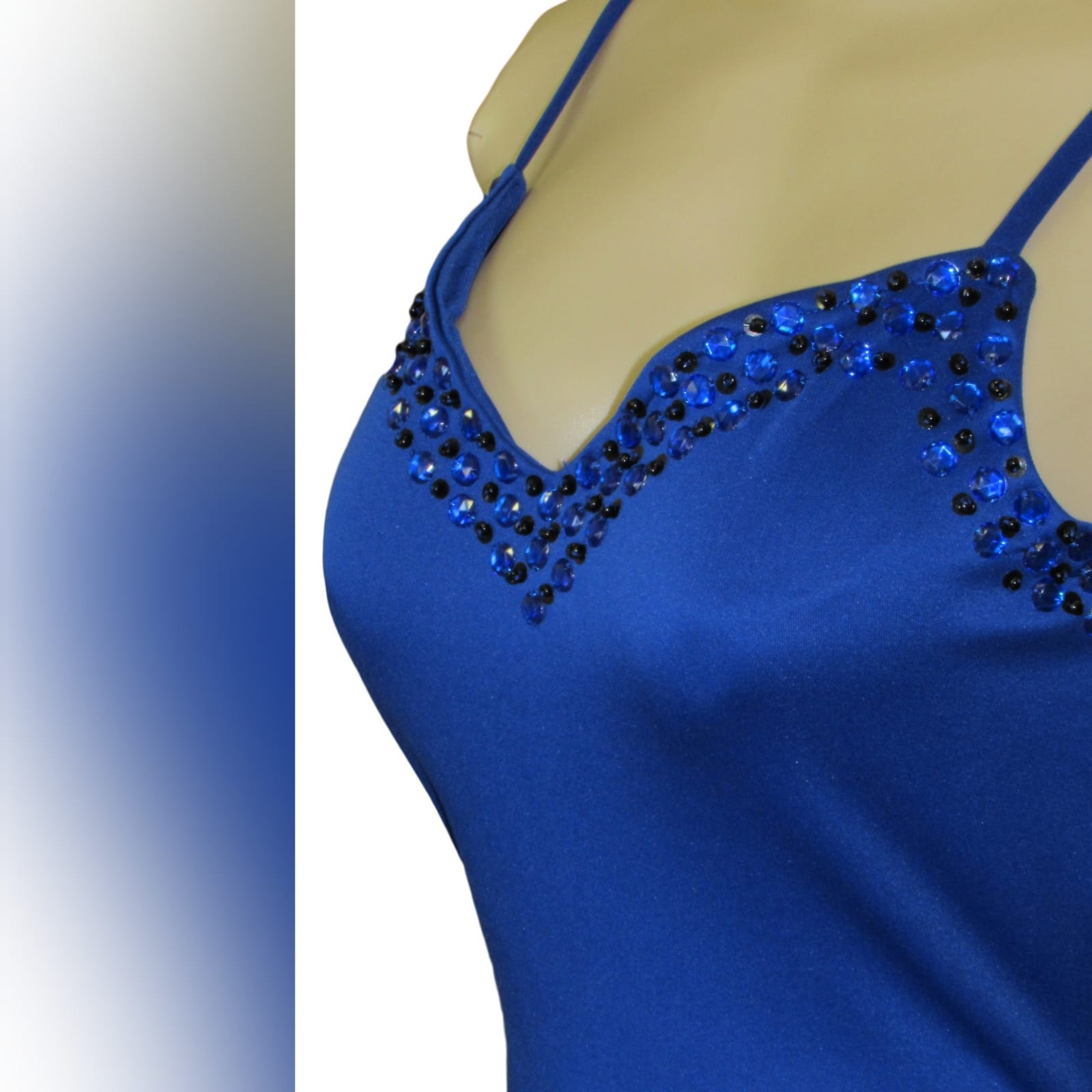 Royal blue soft mermaid beaded prom dress 4 royal blue soft mermaid beaded prom dress, with a v neckline, low v open back detailed with blue and black beads, thin shoulder straps and a long train.