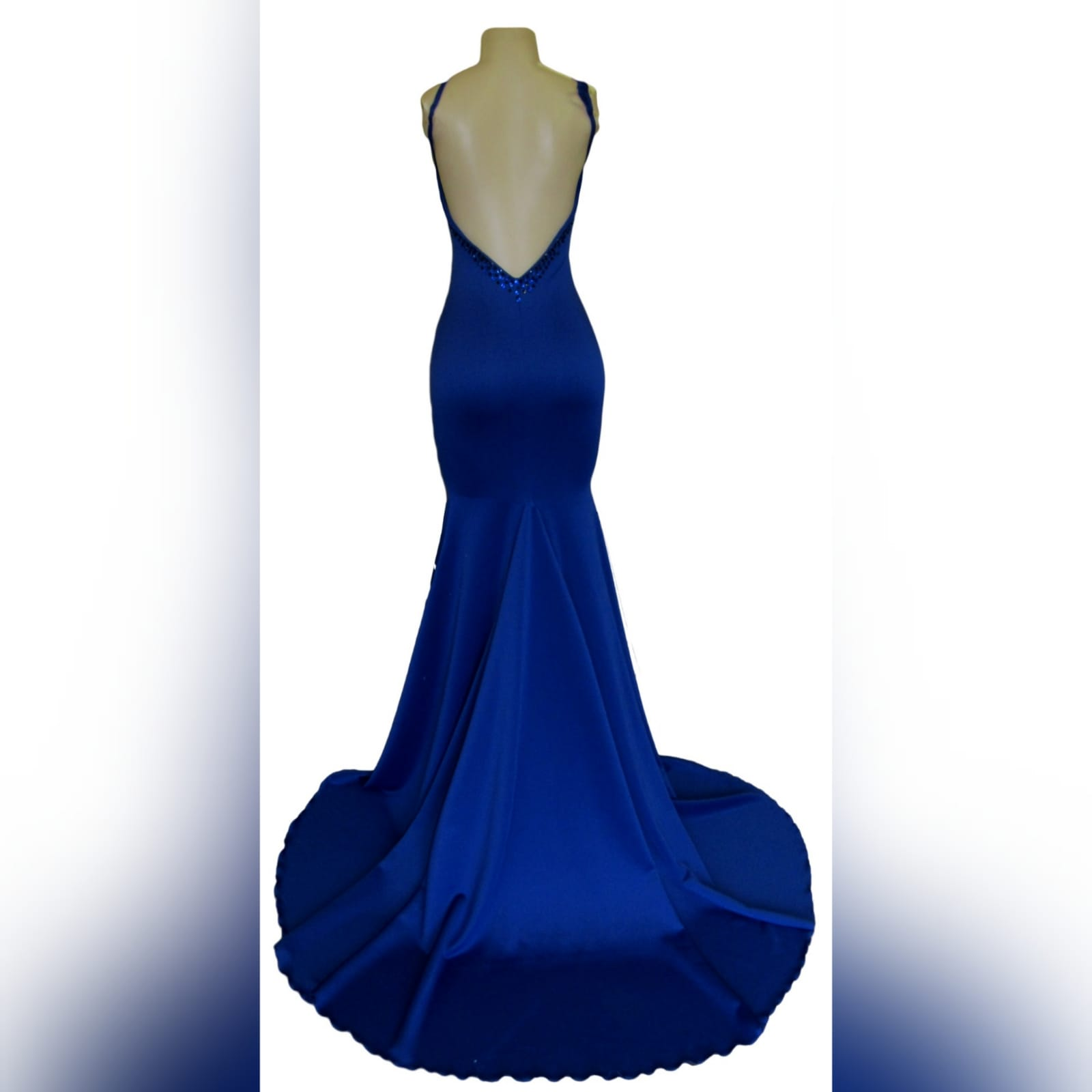 Royal blue soft mermaid beaded prom dress 7 royal blue soft mermaid beaded prom dress, with a v neckline, low v open back detailed with blue and black beads, thin shoulder straps and a long train.