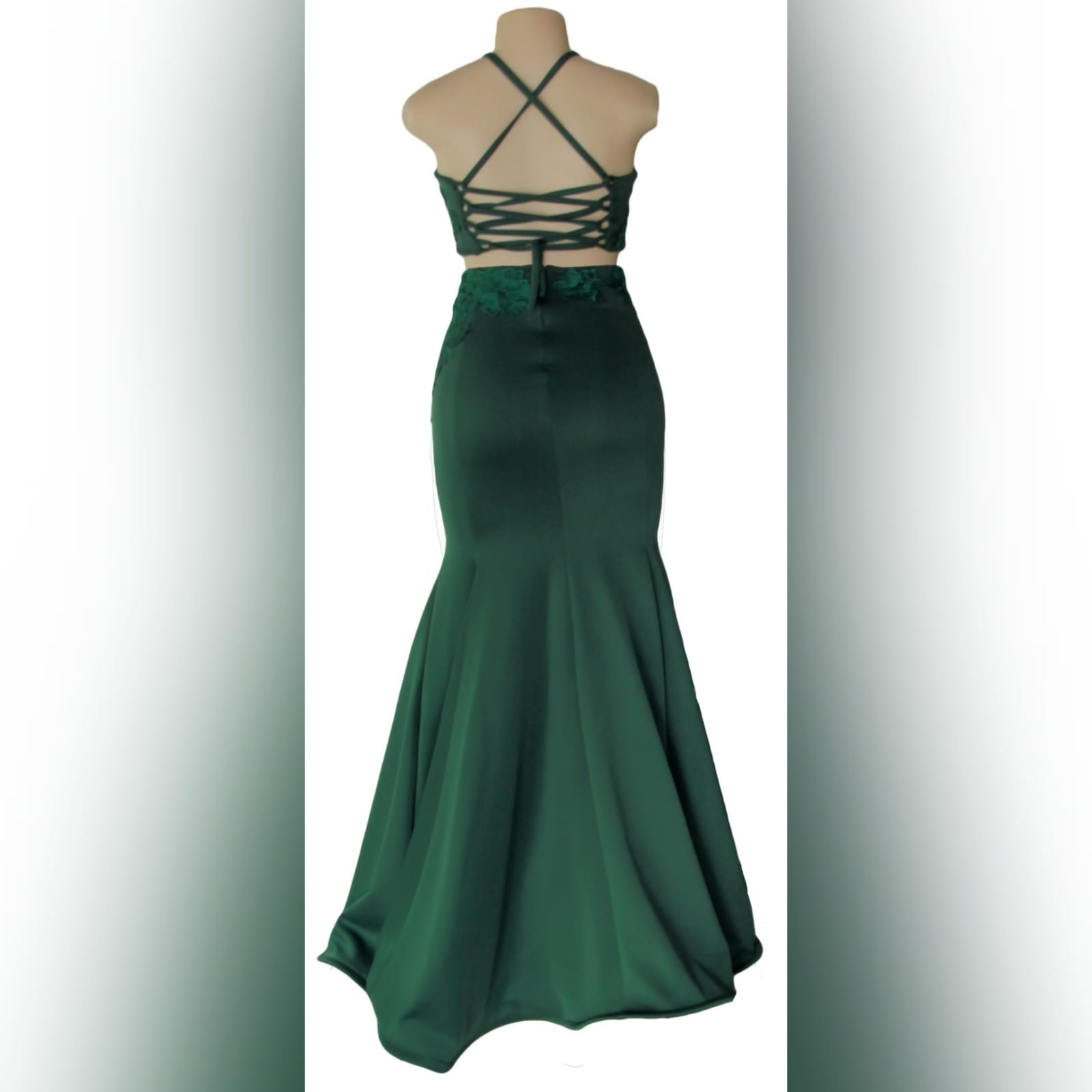 2 piece emerald green mermaid prom dress 4 2 piece emerald green mermaid prom dress. A gorgeous crop top with a lace-up open back, with a mermaid skirt. Lace detail on skirt and top for a classic touch.