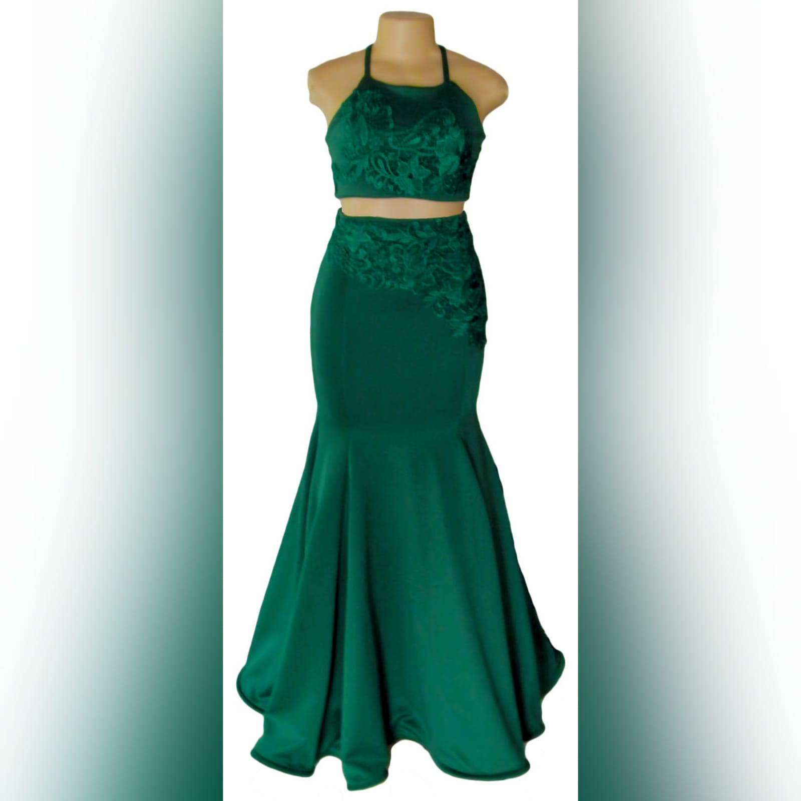 2 piece emerald green mermaid prom dress 5 2 piece emerald green mermaid prom dress. A gorgeous crop top with a lace-up open back, with a mermaid skirt. Lace detail on skirt and top for a classic touch.