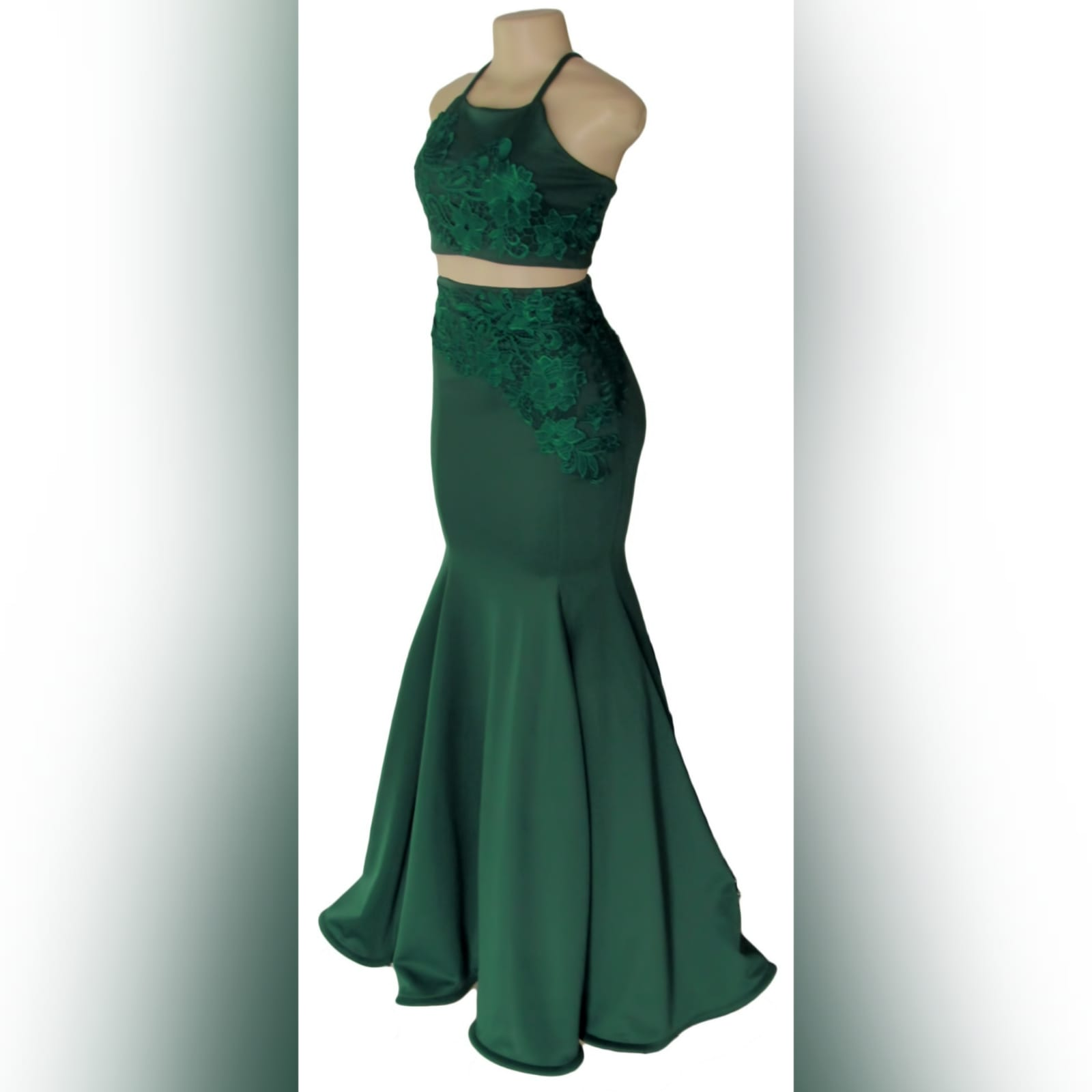 2 piece emerald green mermaid prom dress 8 2 piece emerald green mermaid prom dress. A gorgeous crop top with a lace-up open back, with a mermaid skirt. Lace detail on skirt and top for a classic touch.