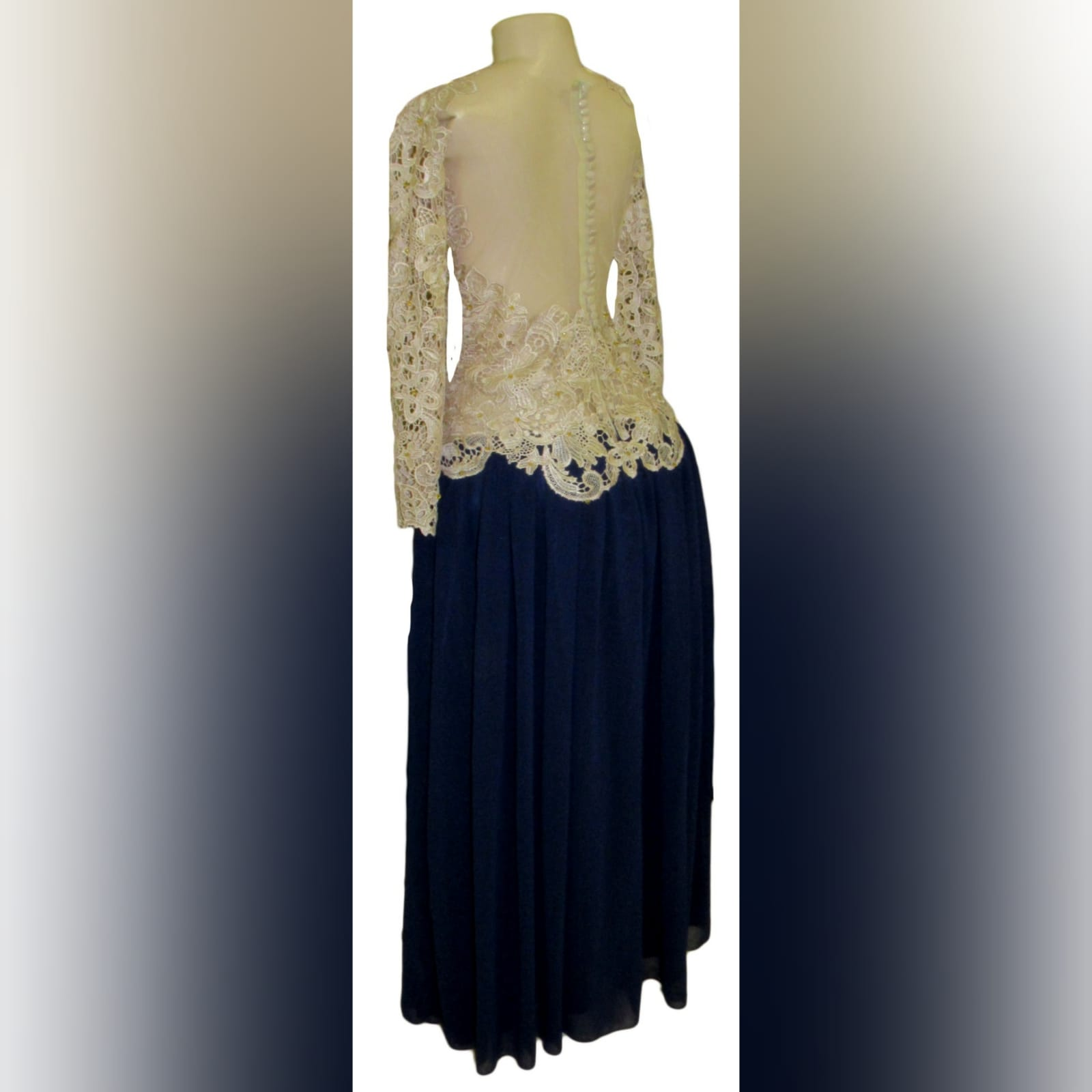 Navy blue and champagne lace prom dress 6 this evening dress design is a classic and can be worn to several occasions. Navy blue and champagne lace prom dress, with a lace bodice and long sleeves, illusion open back detailed with buttons and gold beads. Bottom in a navy blue gathered chiffon adding a great movement to the dress.