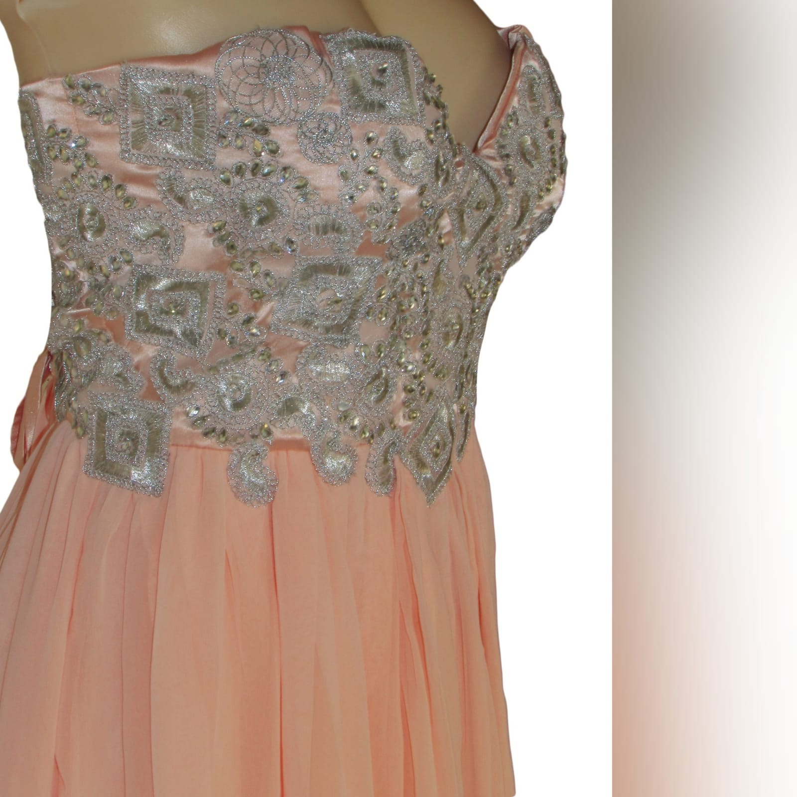Peach and silver fun prom dress 3 peach and silver fun prom dress. Bodice detailed with appliques and beads, with a lace-up back. Bottom with gathered chiffon and an overlayer opened in front.