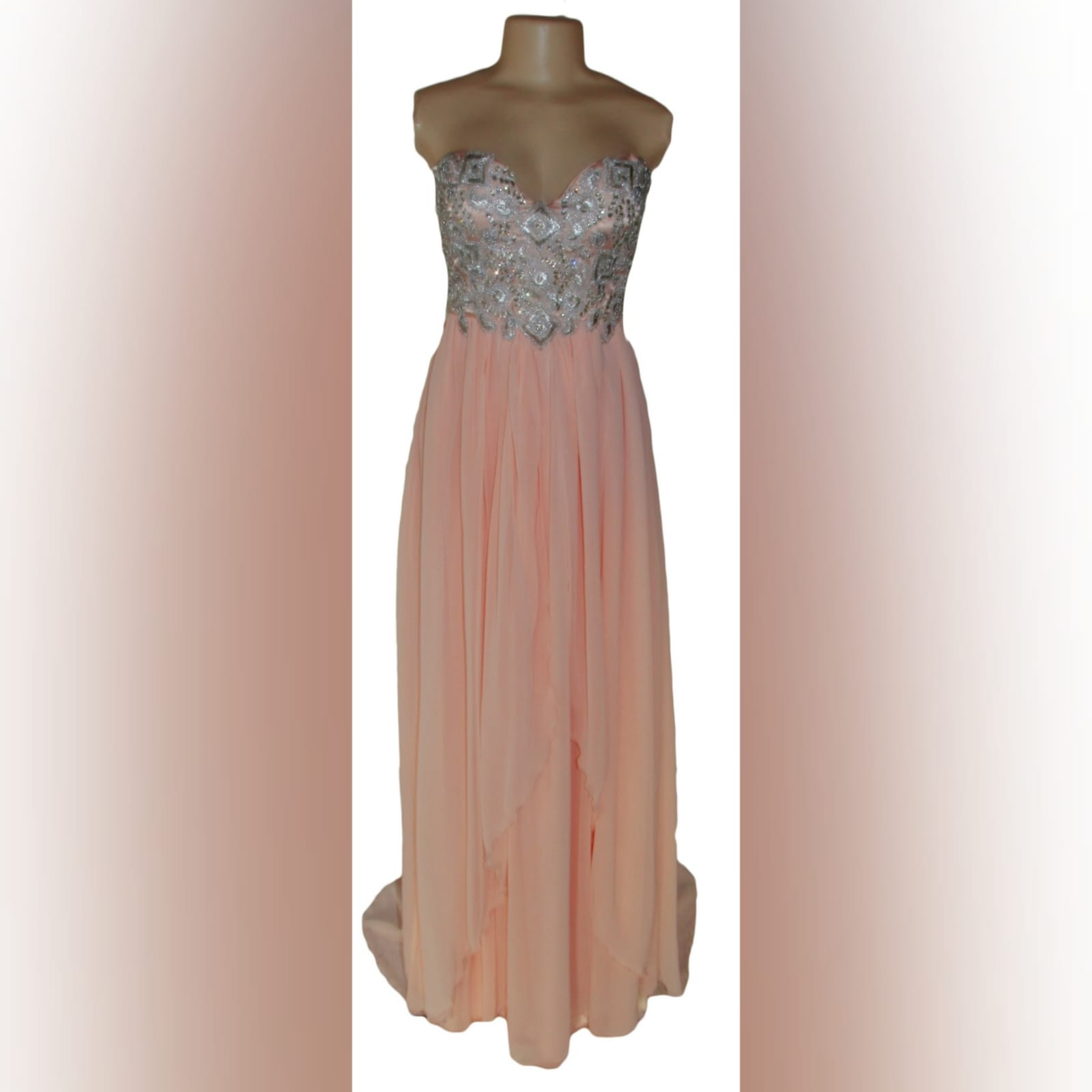 Peach and silver fun prom dress 4 peach and silver fun prom dress. Bodice detailed with appliques and beads, with a lace-up back. Bottom with gathered chiffon and an overlayer opened in front.