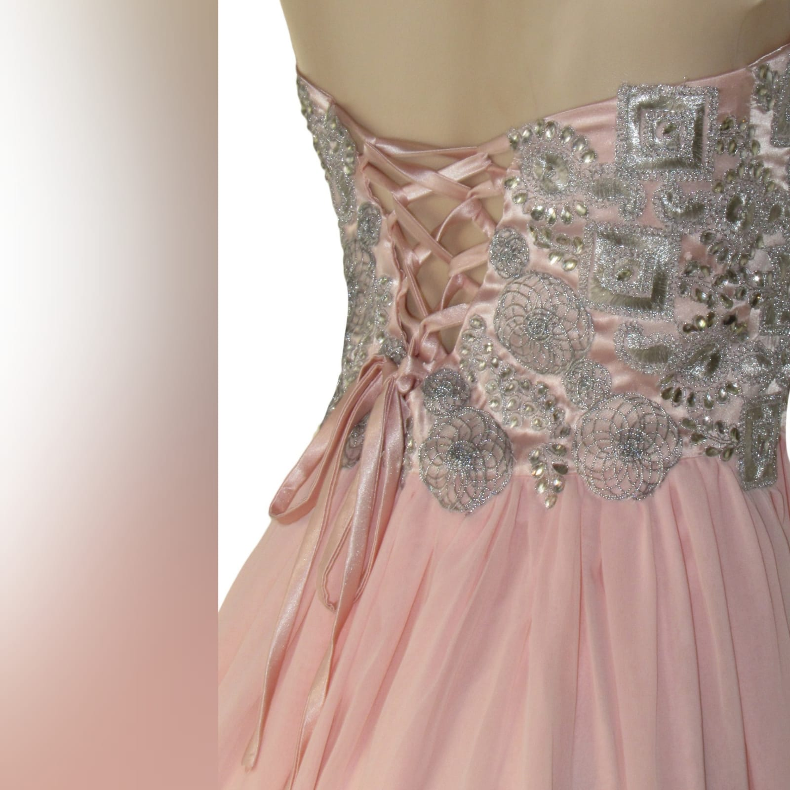 Peach and silver fun prom dress 5 peach and silver fun prom dress. Bodice detailed with appliques and beads, with a lace-up back. Bottom with gathered chiffon and an overlayer opened in front.