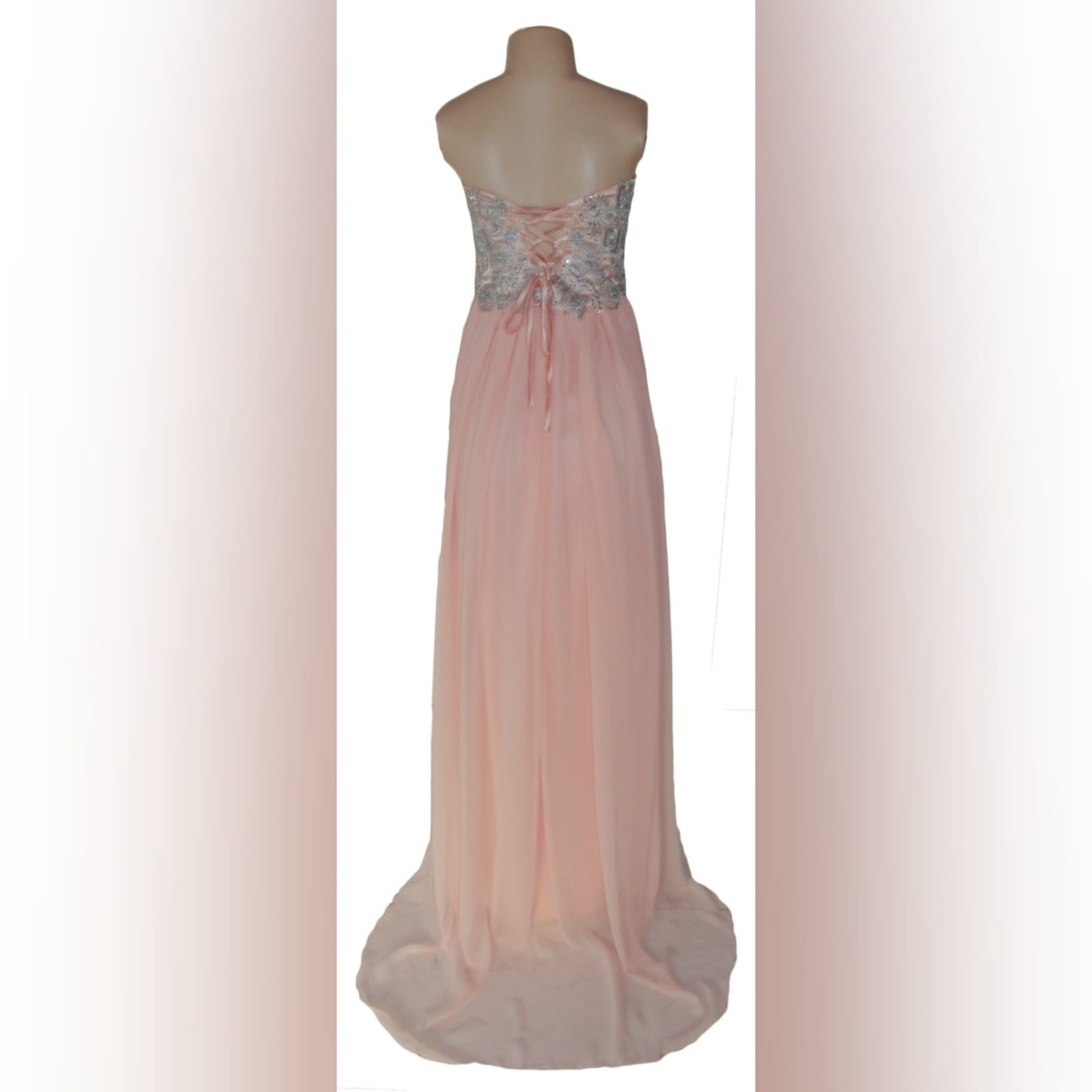 Peach and silver fun prom dress 7 peach and silver fun prom dress. Bodice detailed with appliques and beads, with a lace-up back. Bottom with gathered chiffon and an overlayer opened in front.