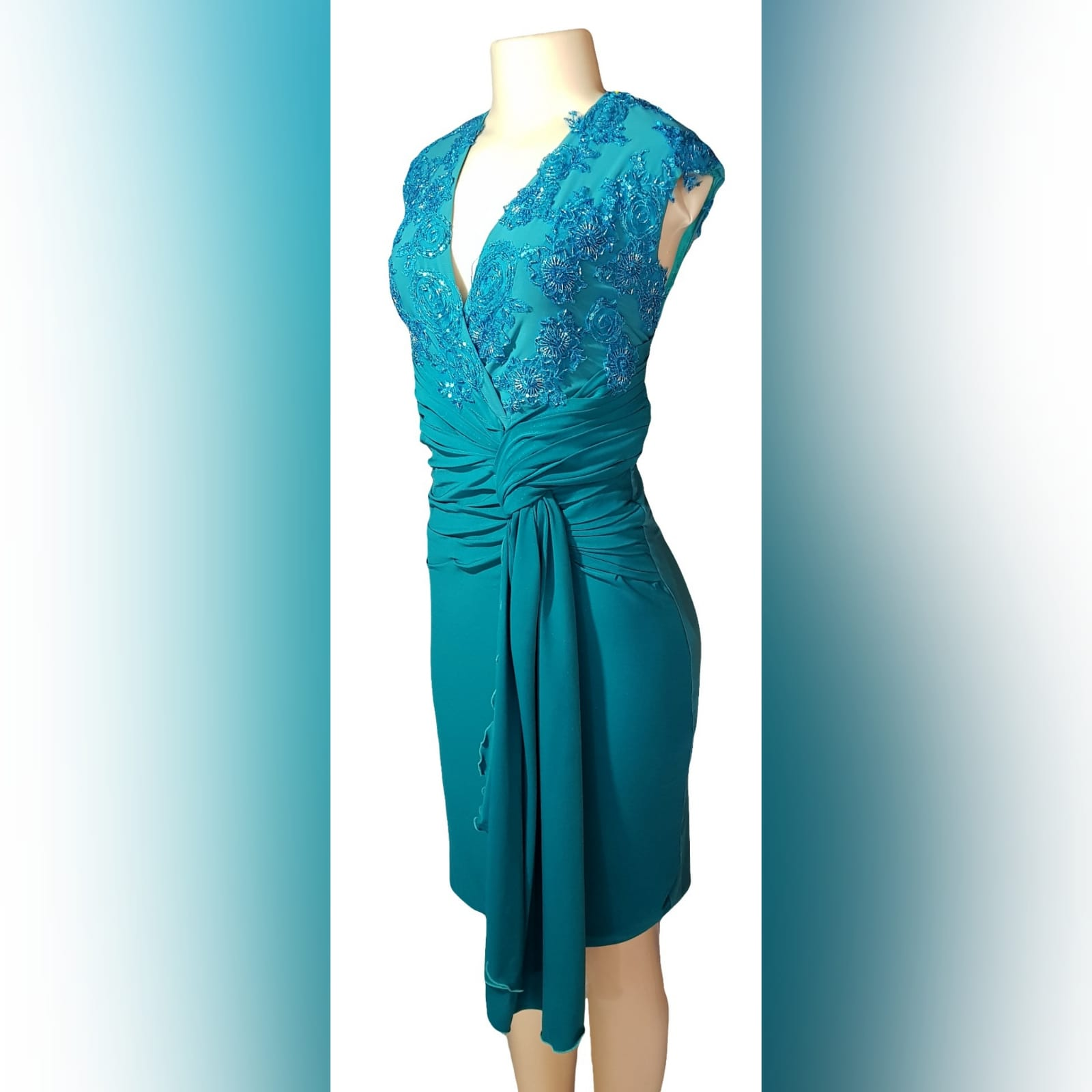 Pencil fit turquoise knee length formal dress 2 a pencil fit turquoise knee length formal dress, created for a wedding for mother of bride. This simple elegant design has a crossed v neckline detailed with beaded lace. A ruched belt with ends on the side over the dress.