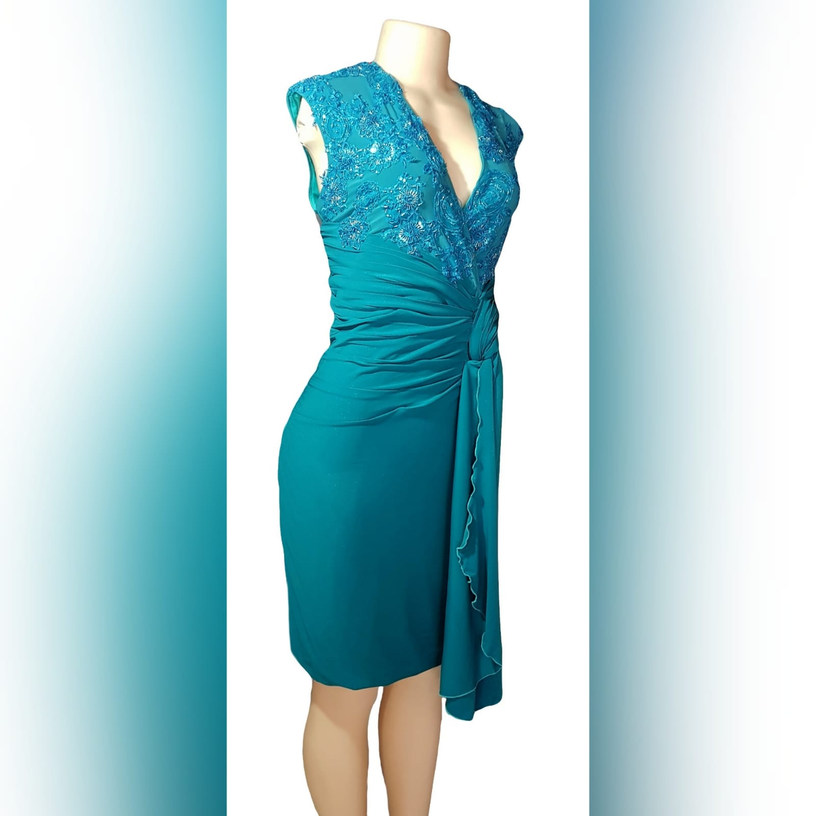 Pencil fit turquoise knee length formal dress 4 a pencil fit turquoise knee length formal dress, created for a wedding for mother of bride. This simple elegant design has a crossed v neckline detailed with beaded lace. A ruched belt with ends on the side over the dress.