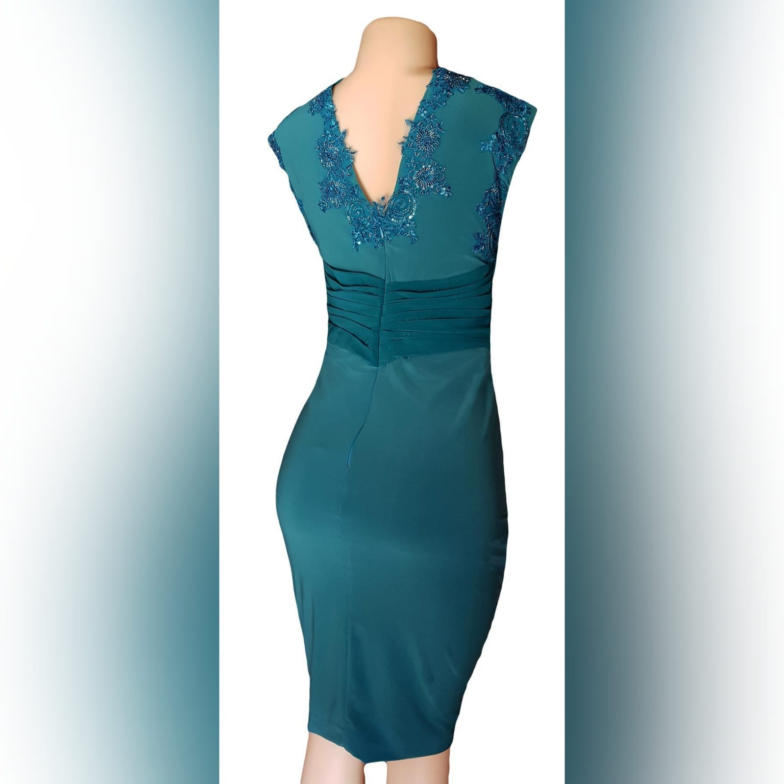 Pencil fit turquoise knee length formal dress 8 a pencil fit turquoise knee length formal dress, created for a wedding for mother of bride. This simple elegant design has a crossed v neckline detailed with beaded lace. A ruched belt with ends on the side over the dress.
