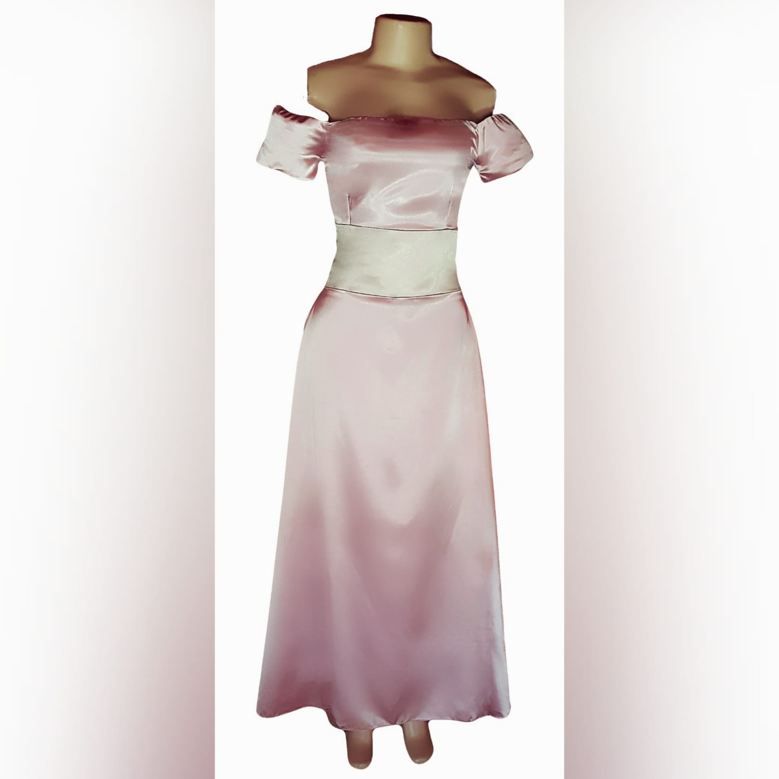 An elegant simple and sophisticated pink and champagne formal dress 9 an elegant, simple and sophisticated pink and champagne formal dress, created for a wedding ceremony. This design was created with a light wear satin, off-shoulder neckline and short sleeves, and a wide champagne belt. Created for a client in south africa.