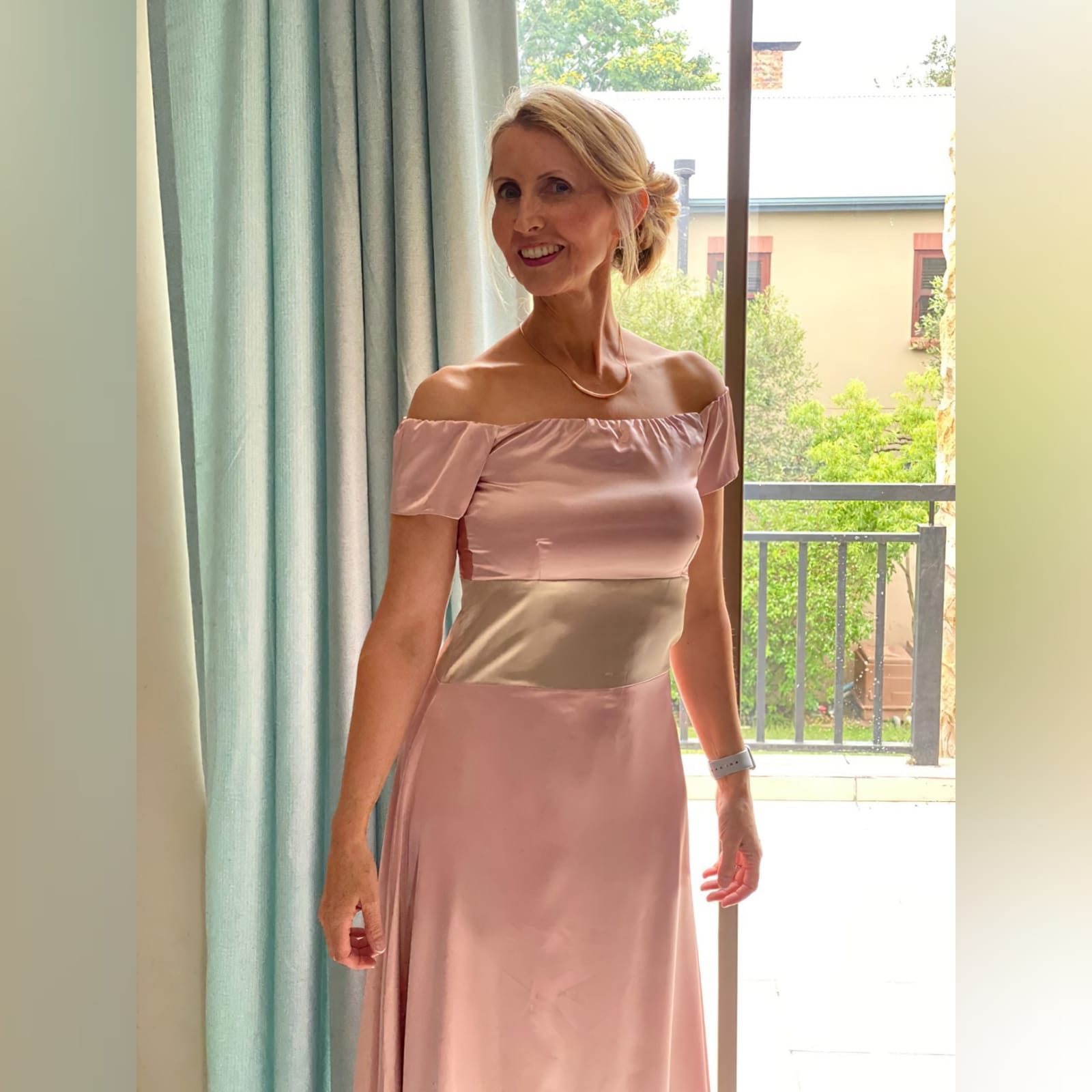 An elegant simple and sophisticated pink and champagne formal dress 2 an elegant, simple and sophisticated pink and champagne formal dress, created for a wedding ceremony. This design was created with a light wear satin, off-shoulder neckline and short sleeves, and a wide champagne belt. Created for a client in south africa.