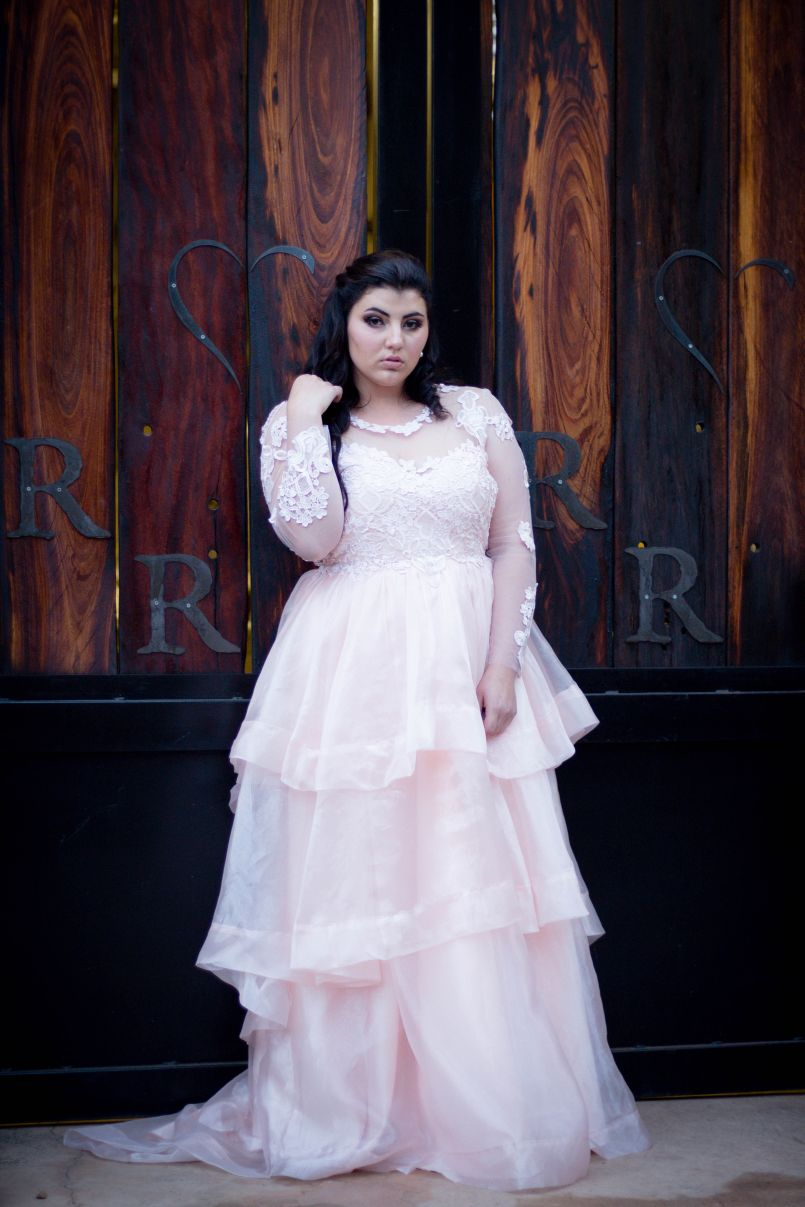 Baby pink long organza and lace prom ballgown 8 Baby pink long organza and lace prom ballgown. This unique dress has a lace bodice with illusion neckline and sleeves and an open back. Bottom with a 3 layer organza design with a little train.