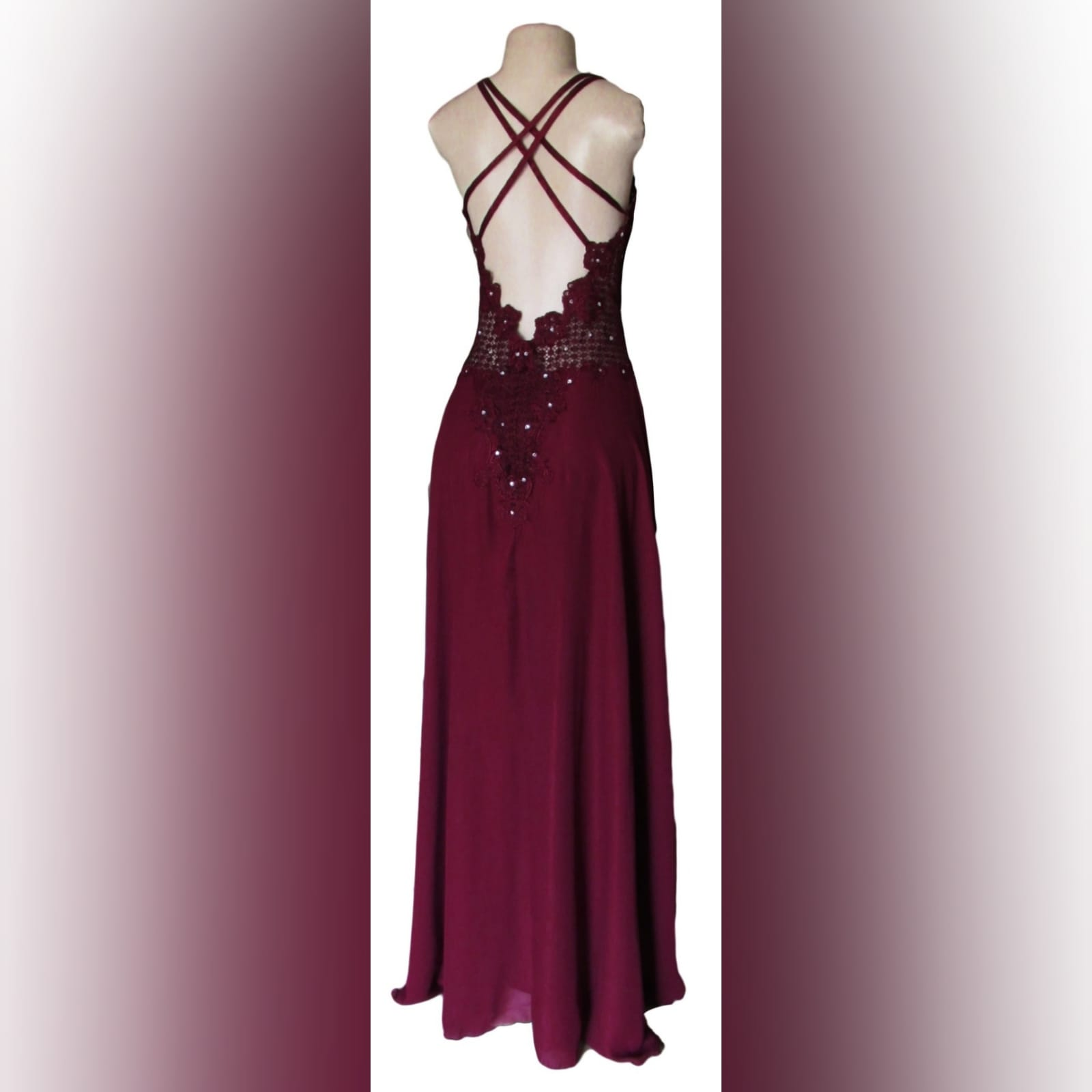 Burgundy chiffon and lace prom dress 8 burgundy chiffon and lace prom dress. Bodice in lace, with a v neckline and v low open back, with double shoulder crossed straps. Bodice detailed with silver beads. Bottom in flowy chiffon with a slit.