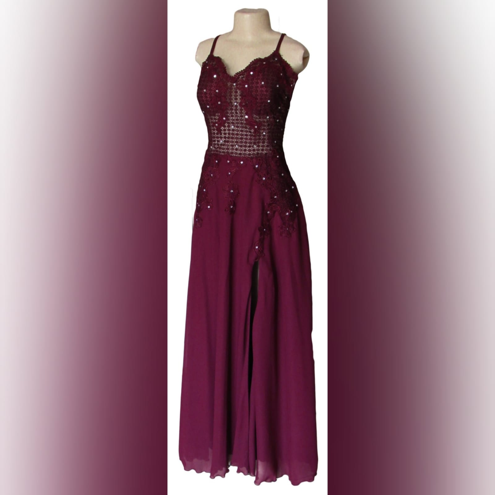 Burgundy chiffon and lace prom dress 4 burgundy chiffon and lace prom dress. Bodice in lace, with a v neckline and v low open back, with double shoulder crossed straps. Bodice detailed with silver beads. Bottom in flowy chiffon with a slit.