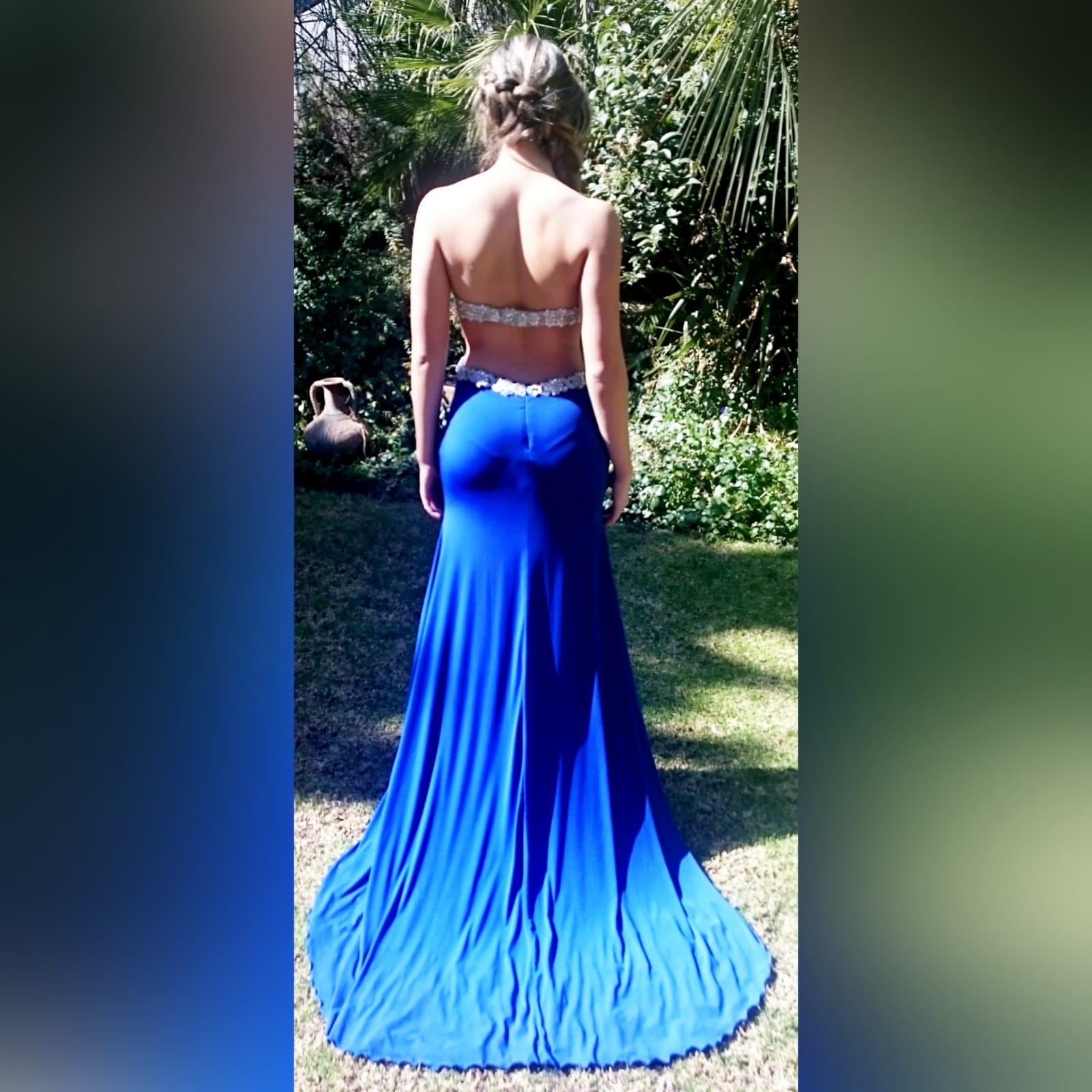 Royal blue and silver sexy ceremony dress 1 royal blue and silver sexy ceremony dress. Designed and made for a prom dance. With a lace and beaded boobtube bodice, a naked back and flowy bottom with a slit and a train.