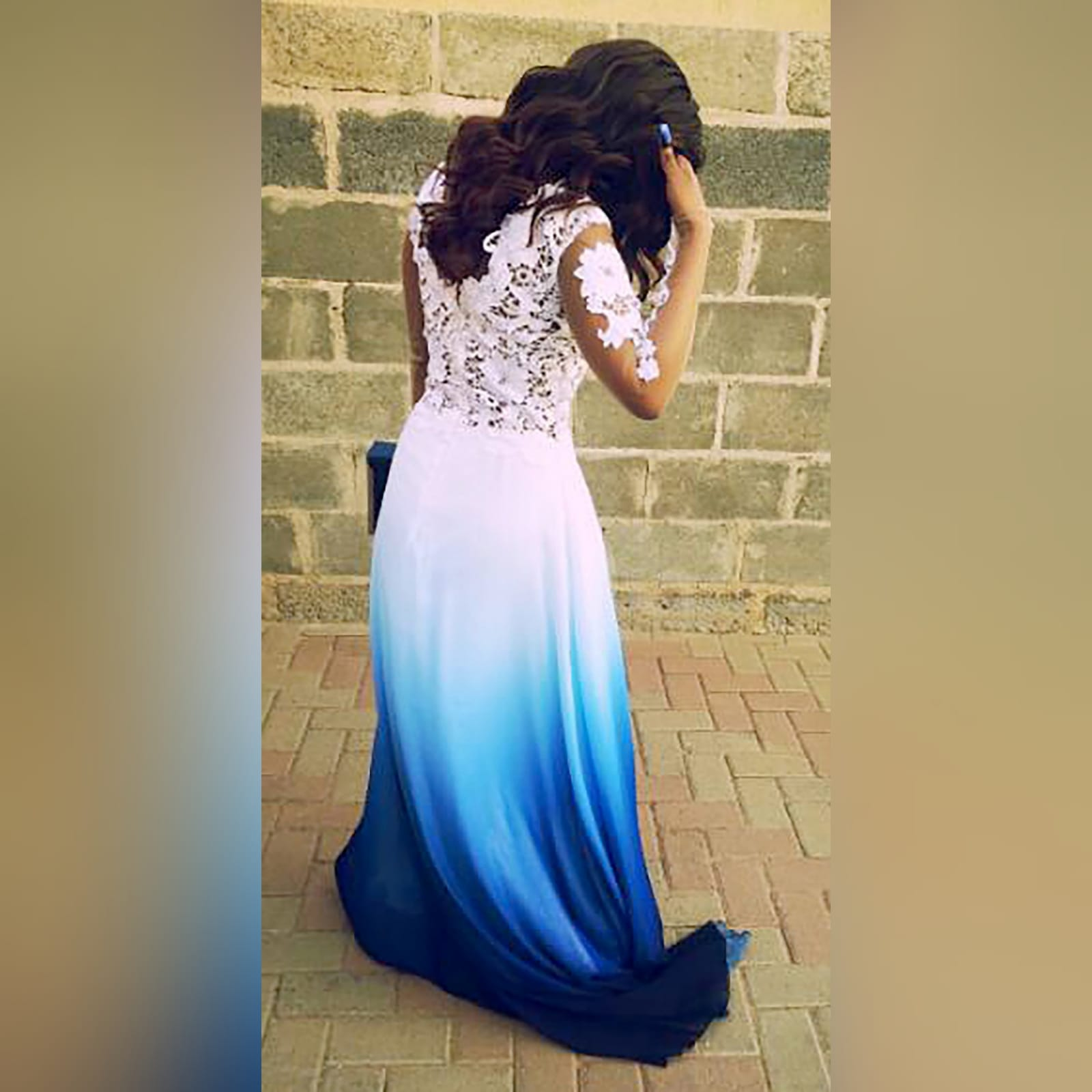 Gorgeous blue and white ombre flowy ceremony dress 2 a gorgeous blue and white ombre flowy ceremony dress created for a prom night. With a classy white bodice with elegant illusion lace sleeves. With a slit and a train