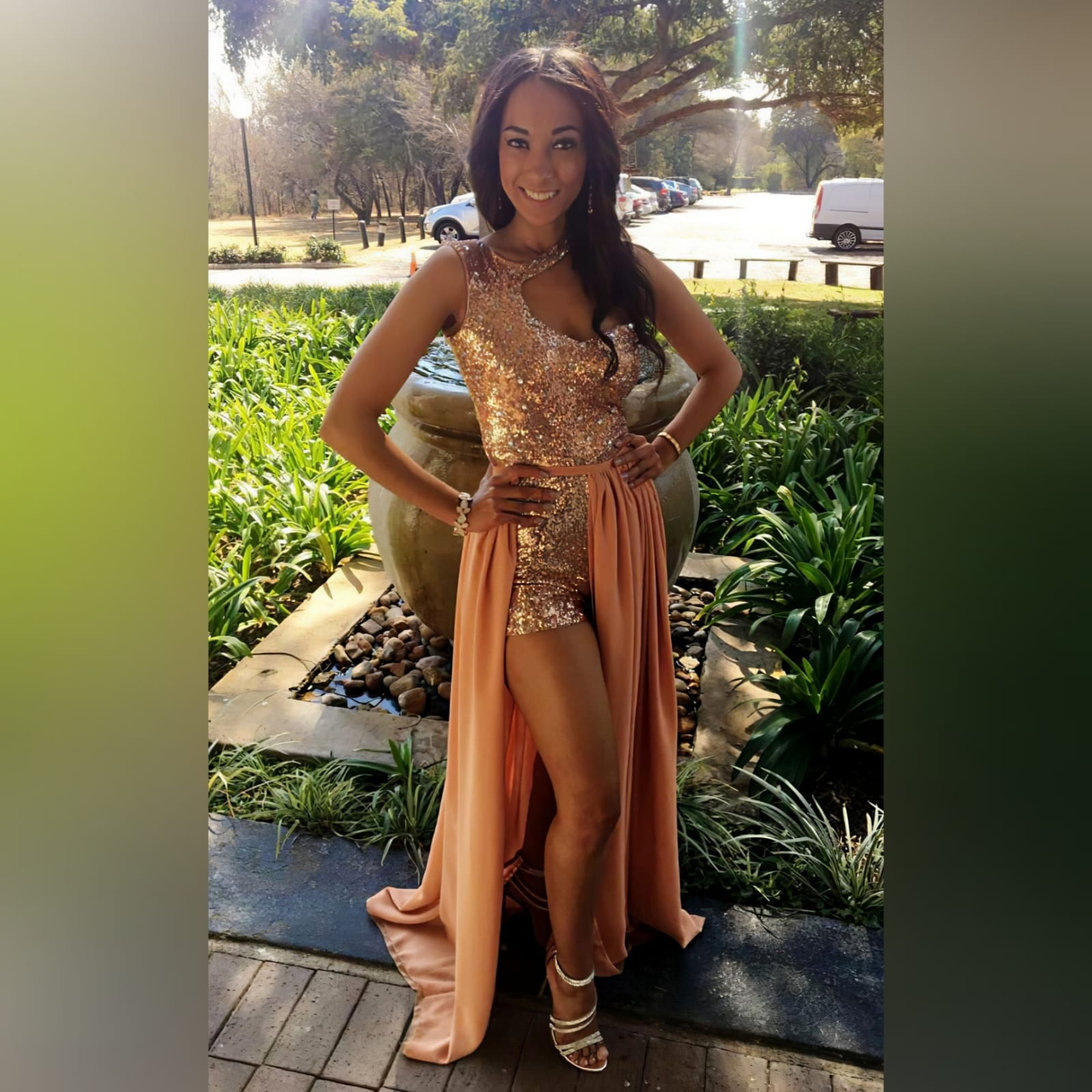 2 piece rose gold evening outfit 4 2 piece rose gold evening outfit , worn at a beauty pageant. A short leg bodysuit with a different neckline. Chiffon removal gathered skirt with a slit and a train