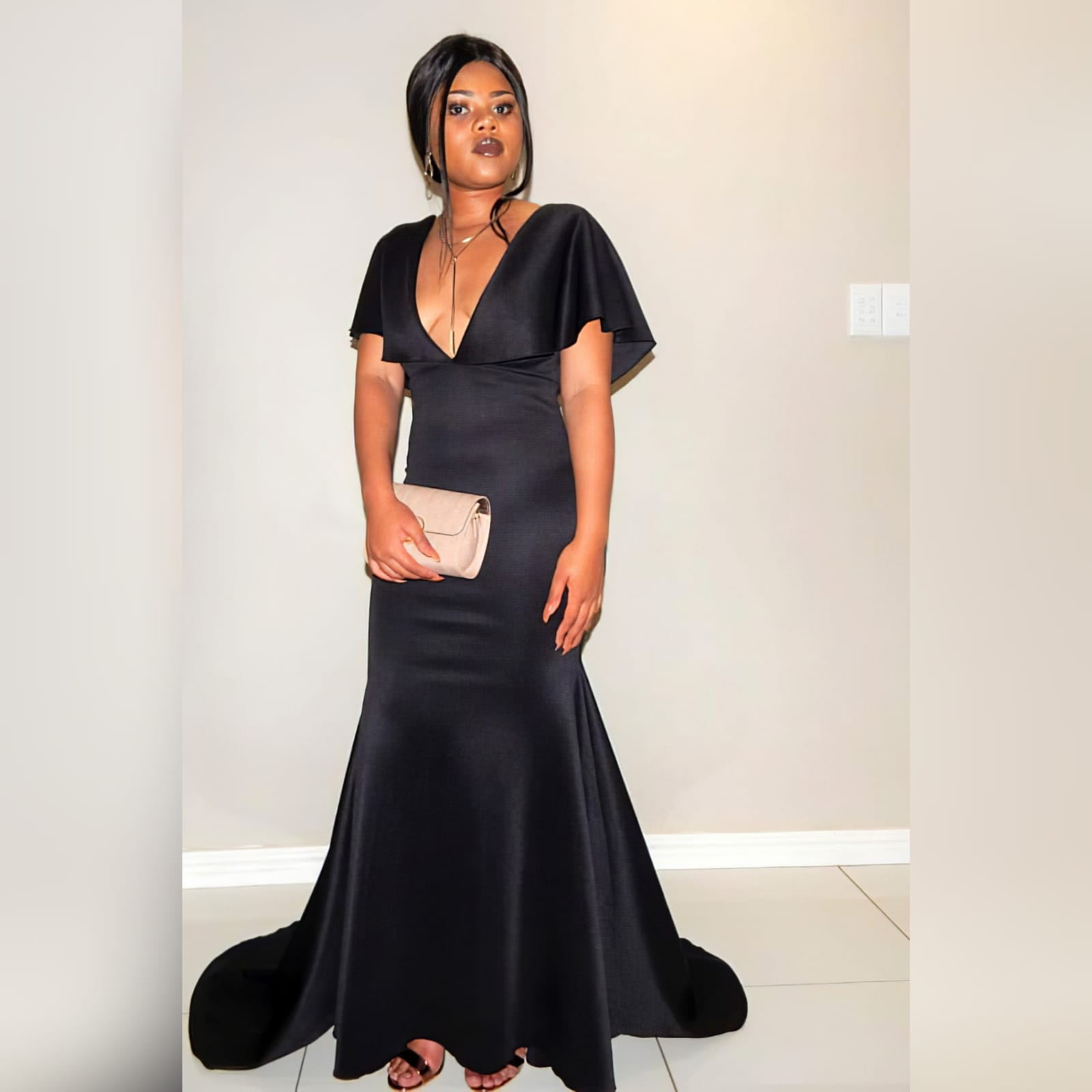 Black soft mermaid simple elegant evening dress 1 black soft mermaid simple elegant evening dress, made for prom night. With a plunging neckline, naked back, wide loose sleeves effect and a train