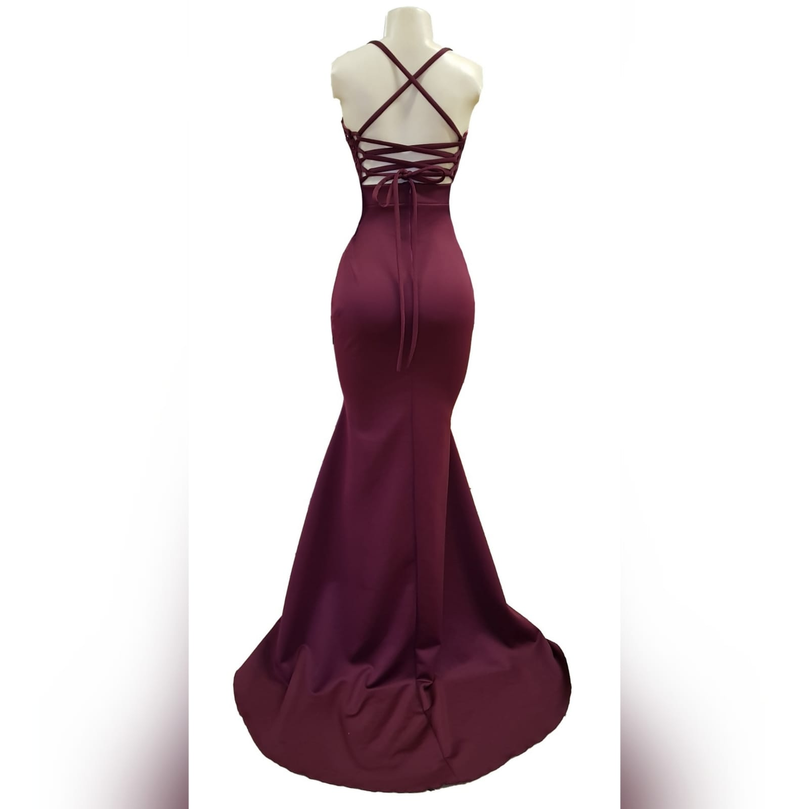 Burgundy soft mermaid plus size prom dress 8 burgundy soft mermaid plus size prom dress. Bodice detailed with lace and silver beads, small triangle opening on the waist with waistband finish. Open laceup back and a train.