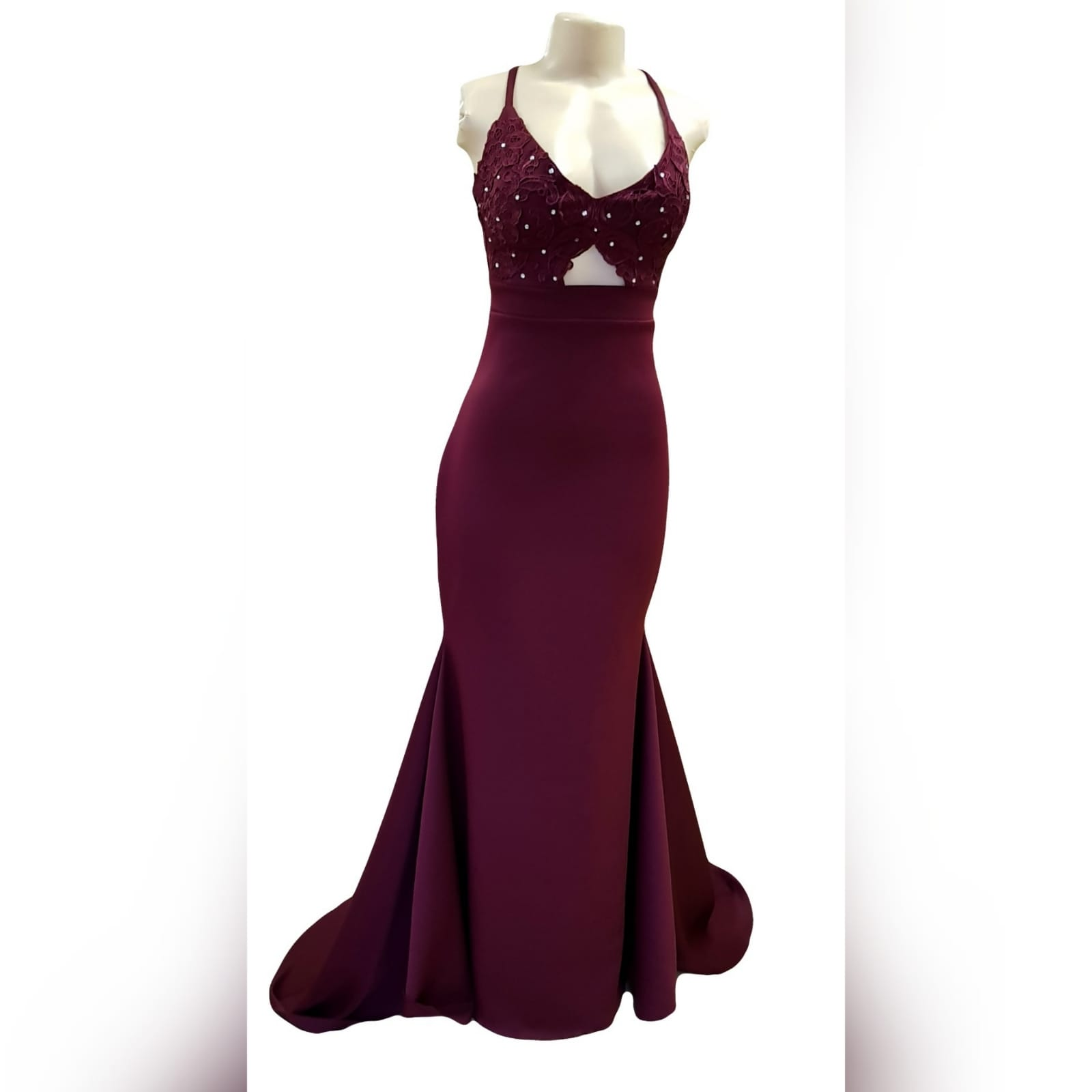Burgundy soft mermaid plus size prom dress 7 burgundy soft mermaid plus size prom dress. Bodice detailed with lace and silver beads, small triangle opening on the waist with waistband finish. Open laceup back and a train.
