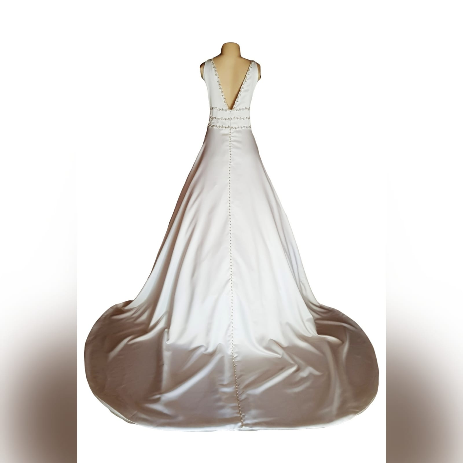 A line brides dress in a pearl satin fabric 17 this elegant wedding dress was designed and made for a wedding in brazilan a-line brides dress in a pearl satin fabric, with an illusion deep neckline and v open back. Detailed with diamante, pearls and buttons. A wide train that hooks up. And a brazilian traditional embroidered inside hem with the bridesmaid's names.
