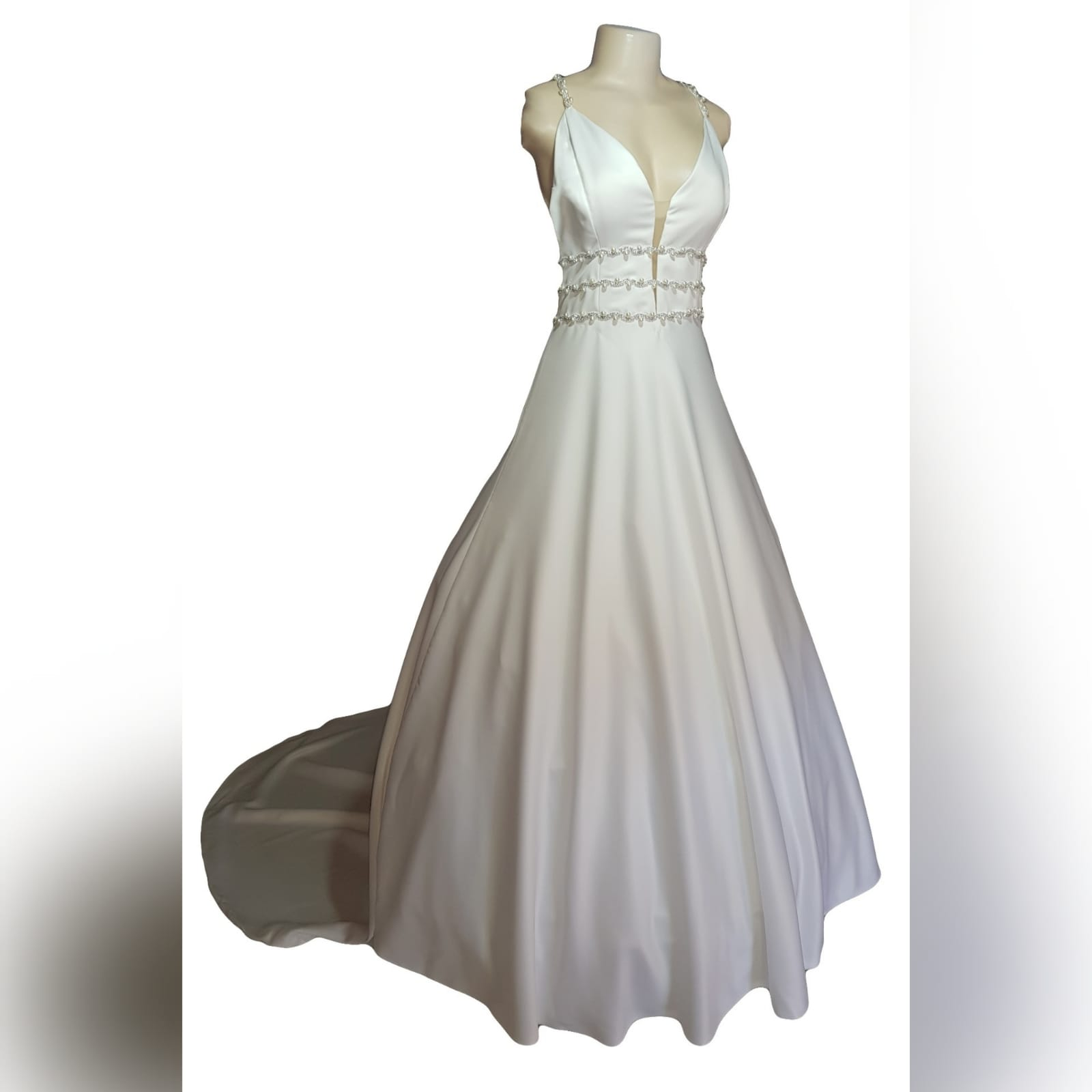A line brides dress in a pearl satin fabric 19 this elegant wedding dress was designed and made for a wedding in brazil an a-line brides dress in a pearl satin fabric, with an illusion deep neckline and v open back. Detailed with diamante, pearls and buttons. A wide train that hooks up. And a brazilian traditional embroidered inside hem with the bridesmaid's names.